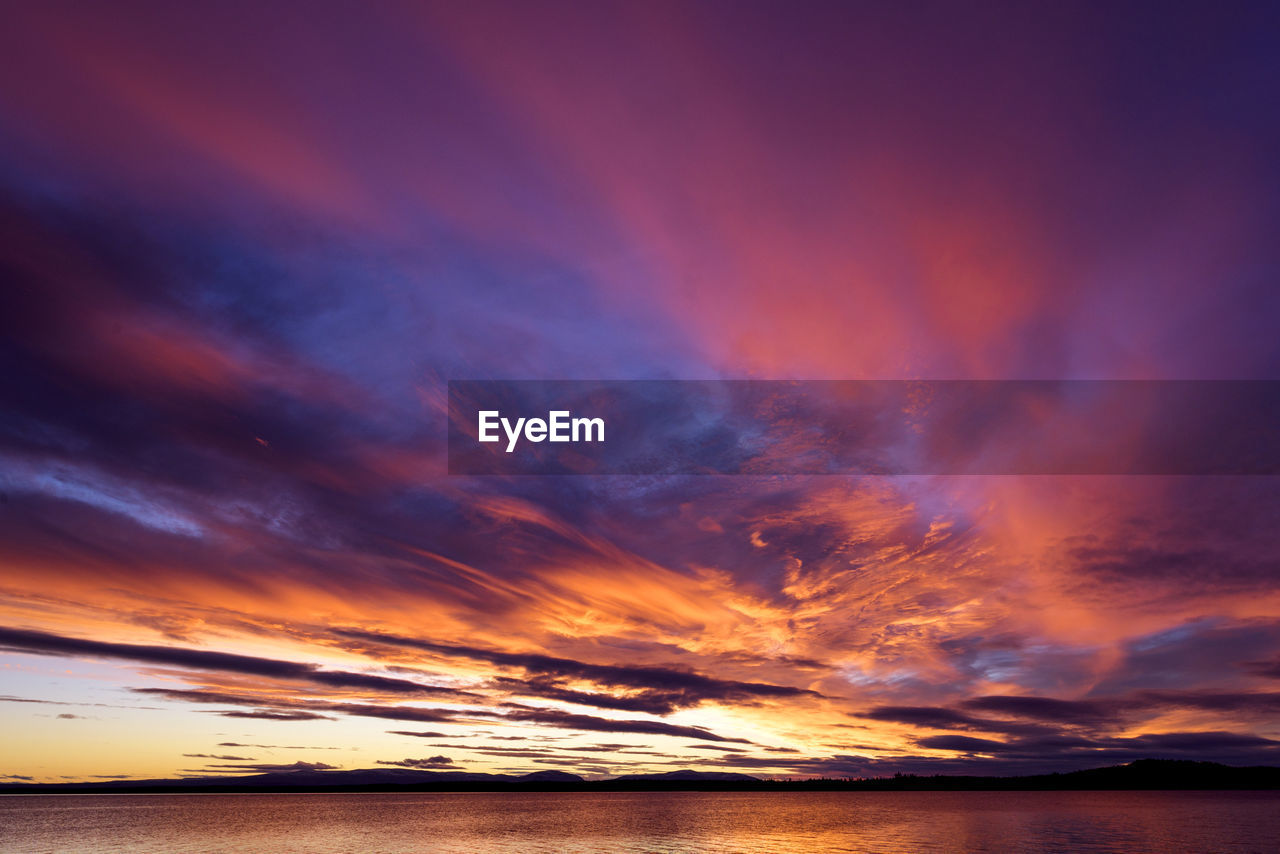 cloud - sky, sky, beauty in nature, sea, water, scenics - nature, sunset, orange color, tranquility, tranquil scene, no people, waterfront, idyllic, horizon, nature, horizon over water, dramatic sky, outdoors, non-urban scene, romantic sky