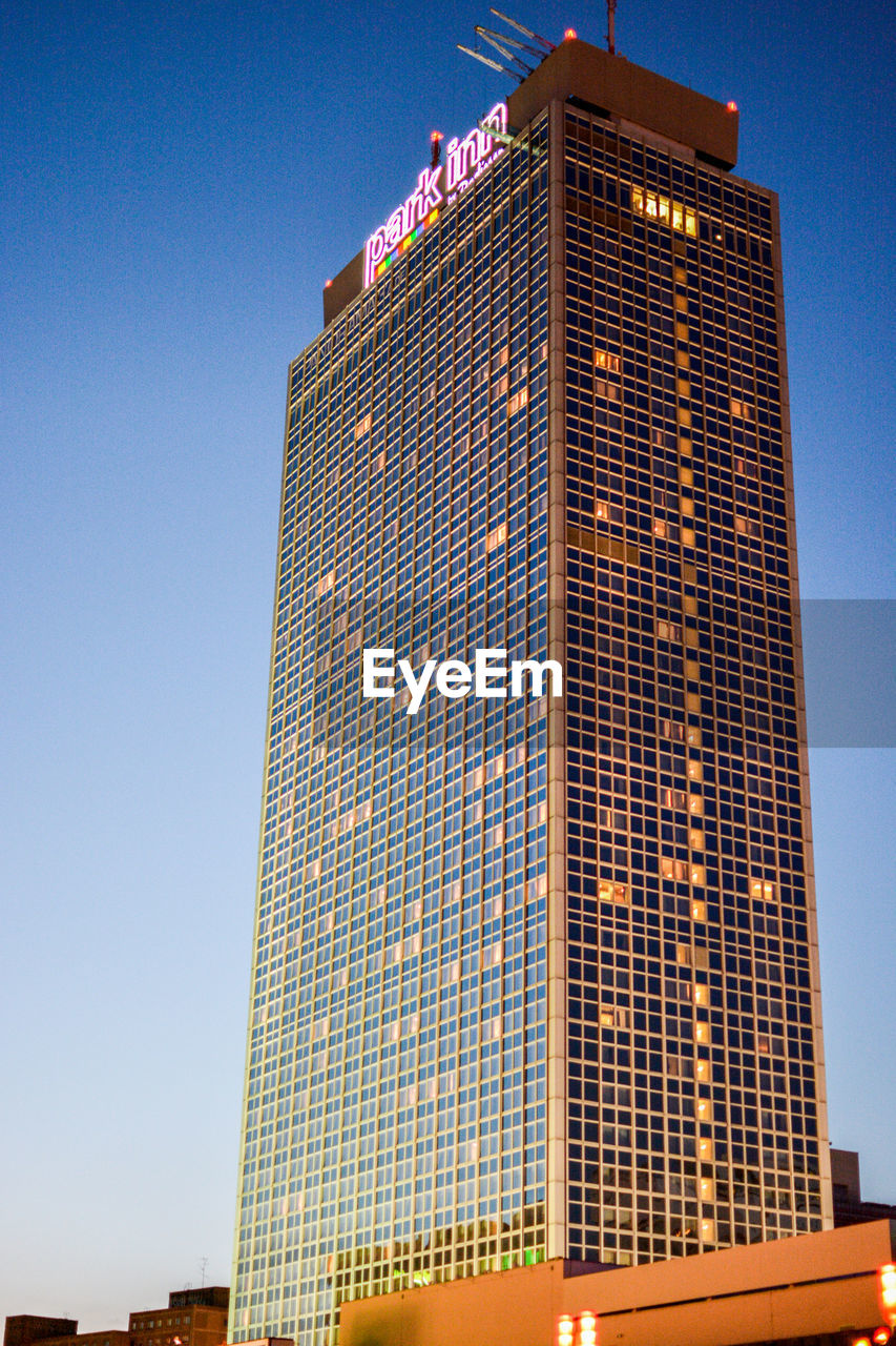 architecture, skyscraper, building exterior, low angle view, built structure, tall - high, clear sky, day, outdoors, window, blue, modern, no people, city, sky