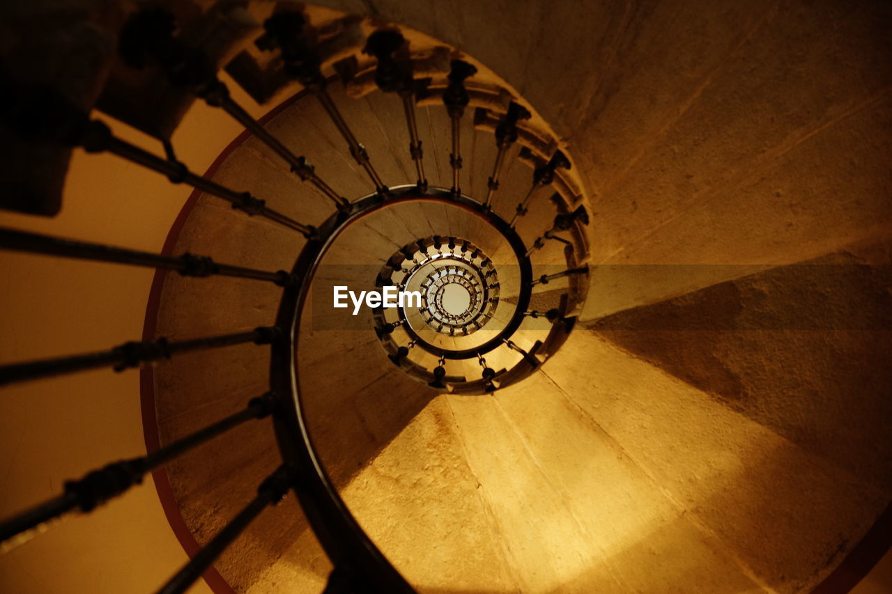 staircase, spiral, steps and staircases, architecture, spiral staircase, railing, built structure, indoors, no people, pattern, design, shape, high angle view, directly below, diminishing perspective, geometric shape, circle, building, absence, wood - material, classical style