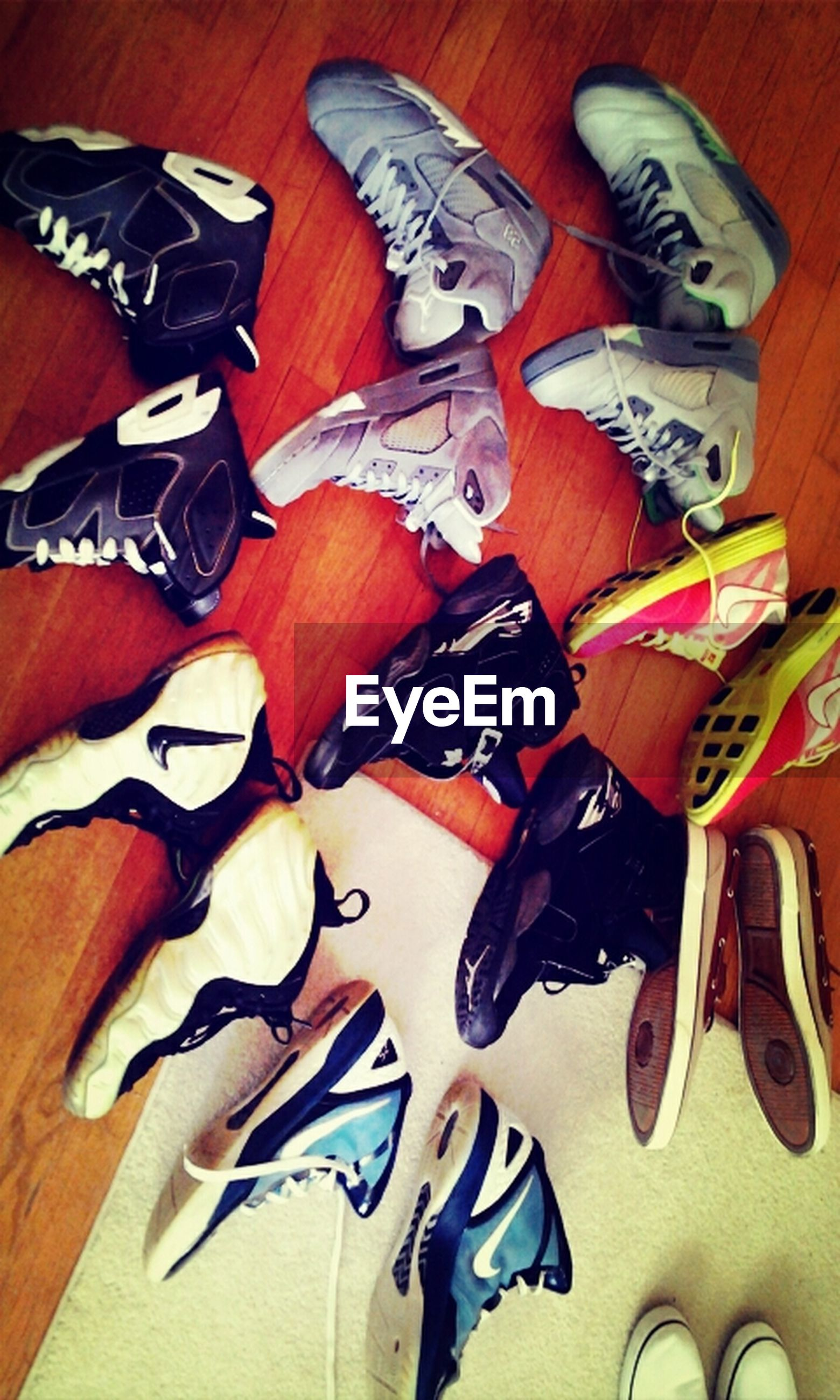 indoors, high angle view, variation, shoe, still life, large group of objects, arrangement, in a row, table, choice, abundance, pair, multi colored, directly above, footwear, side by side, no people, flooring, art and craft, close-up