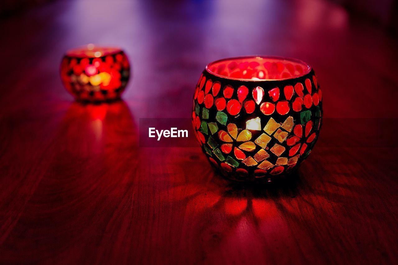 Illuminated tea lights on table