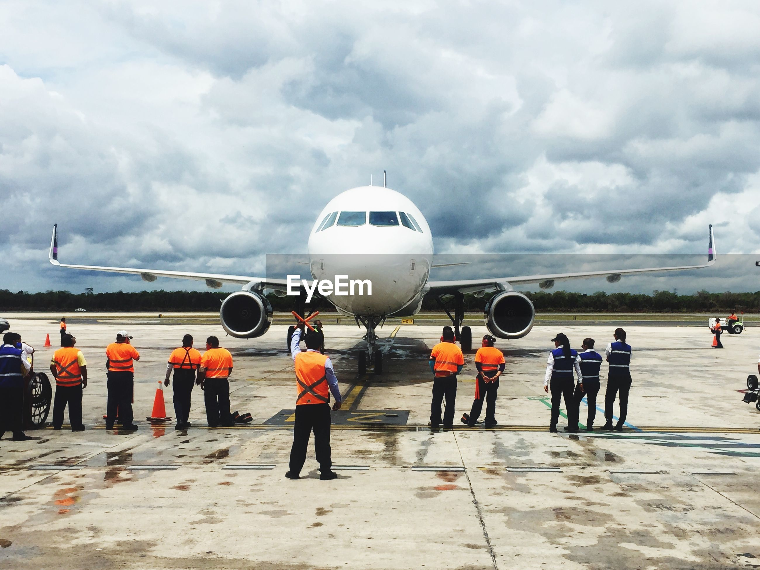 sky, transportation, cloud - sky, airplane, mode of transport, airport, air vehicle, men, cloudy, travel, public transportation, lifestyles, standing, journey, rear view, walking, person, leisure activity, cloud