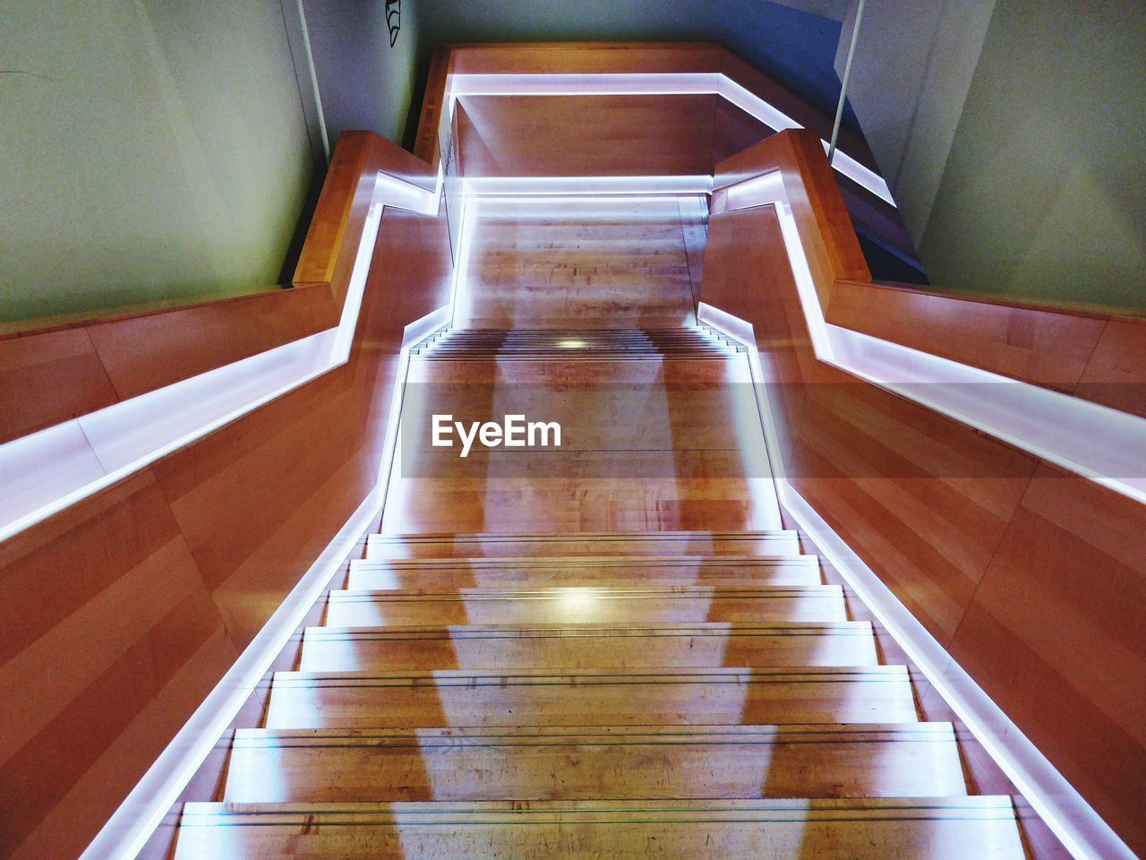indoors, staircase, architecture, no people, steps and staircases, the way forward, high angle view, absence, direction, empty, railing, built structure, wood - material, wood, illuminated, seat, transportation, day, diminishing perspective