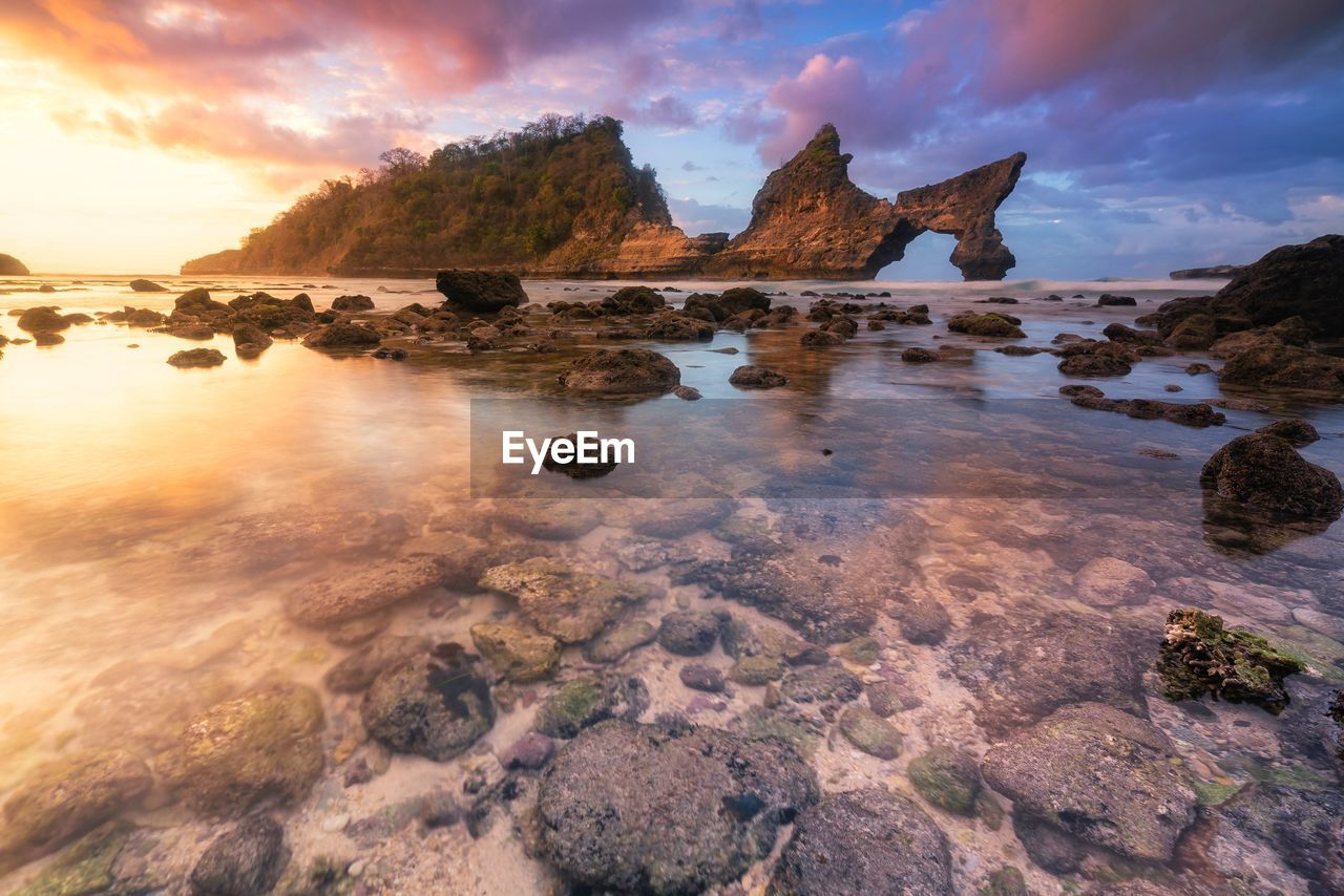 sky, water, rock, cloud - sky, rock - object, solid, sunset, beauty in nature, tranquility, sea, scenics - nature, nature, tranquil scene, rock formation, no people, land, idyllic, beach, non-urban scene, shallow