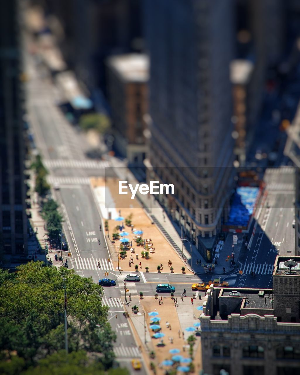 High angle tiltshift view of city street and flatiron building
