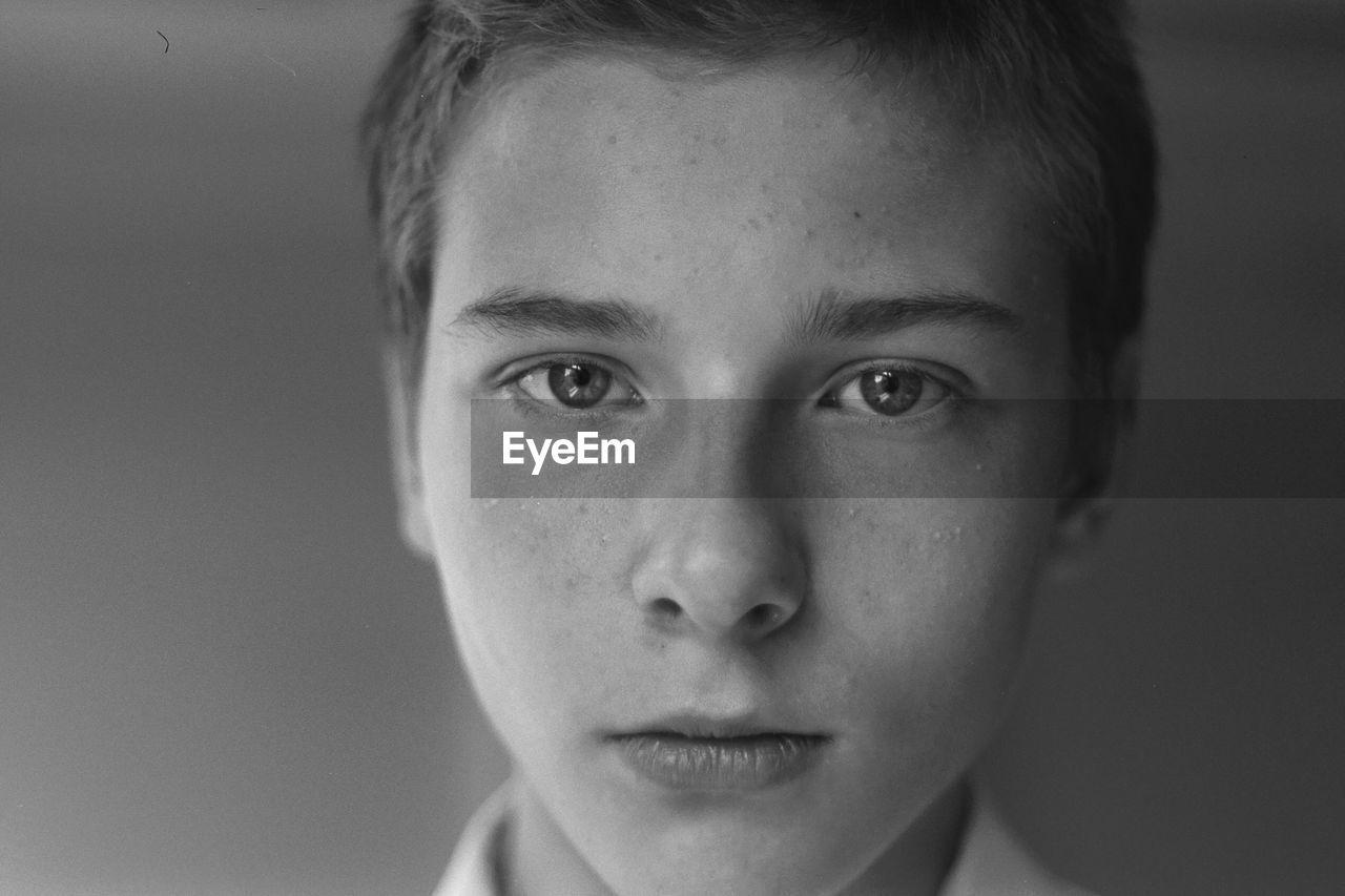 Close-up portrait of serious boy