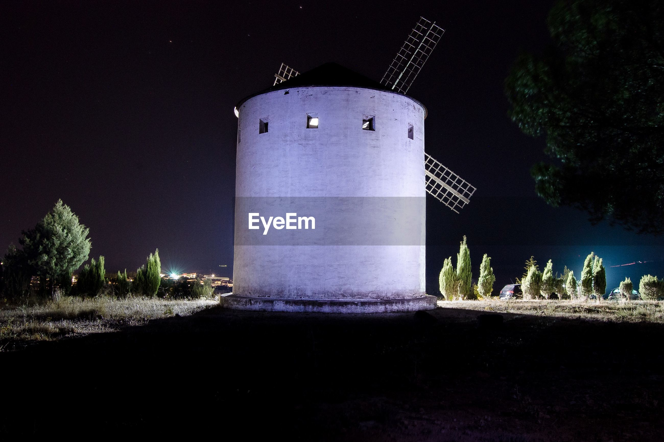 View of windmill at night