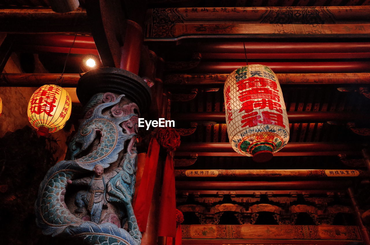 lighting equipment, belief, place of worship, religion, art and craft, hanging, lantern, no people, low angle view, architecture, indoors, spirituality, built structure, building, creativity, ceiling, chinese lantern, ornate, paper lantern