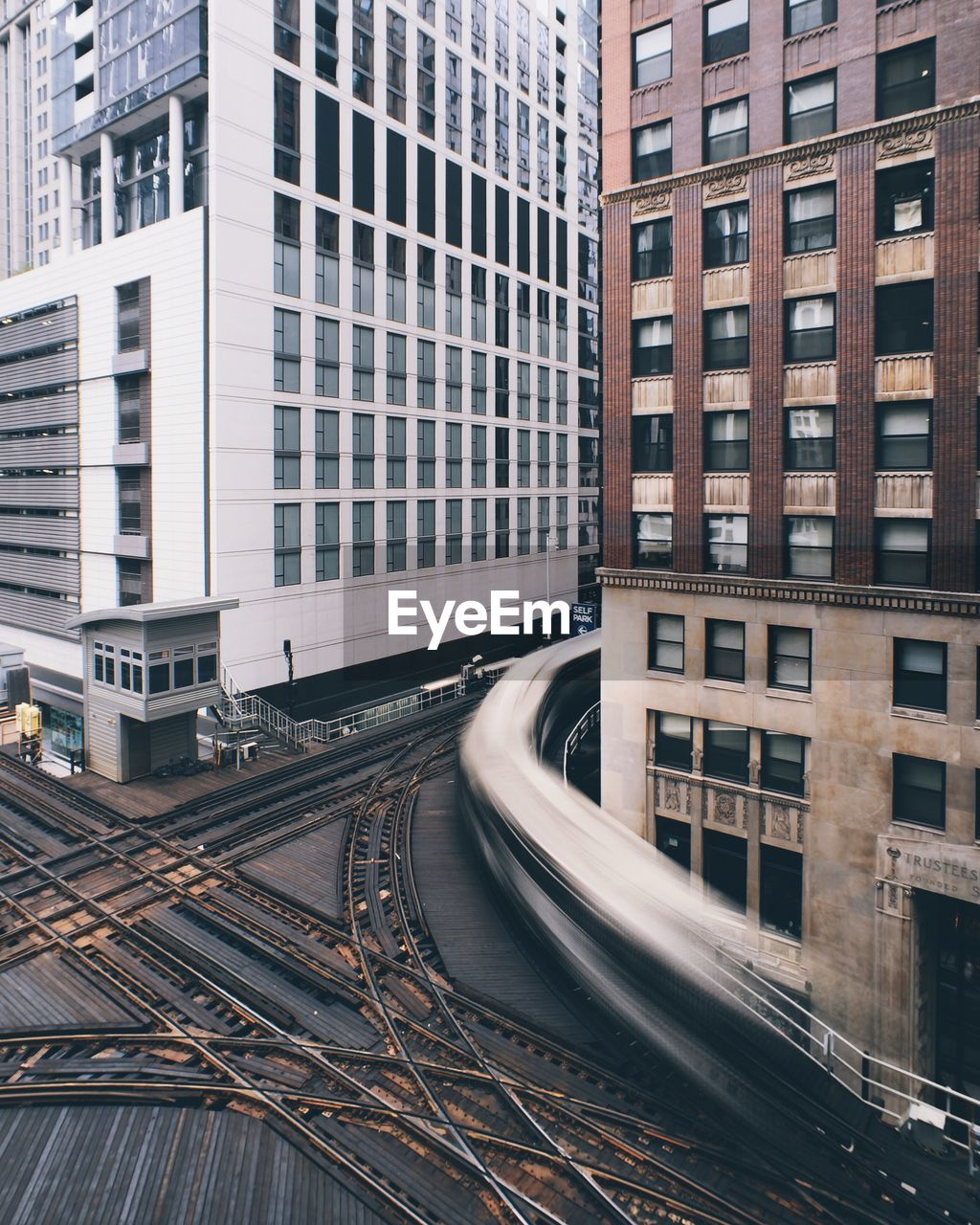 Train On Tracks Amidst Buildings