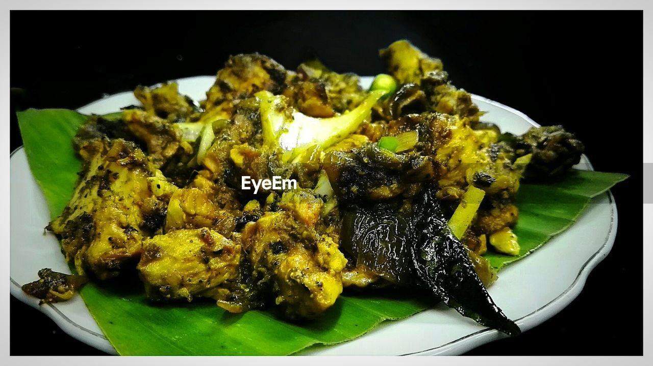 Close-Up Of Chicken On Banana Leaf