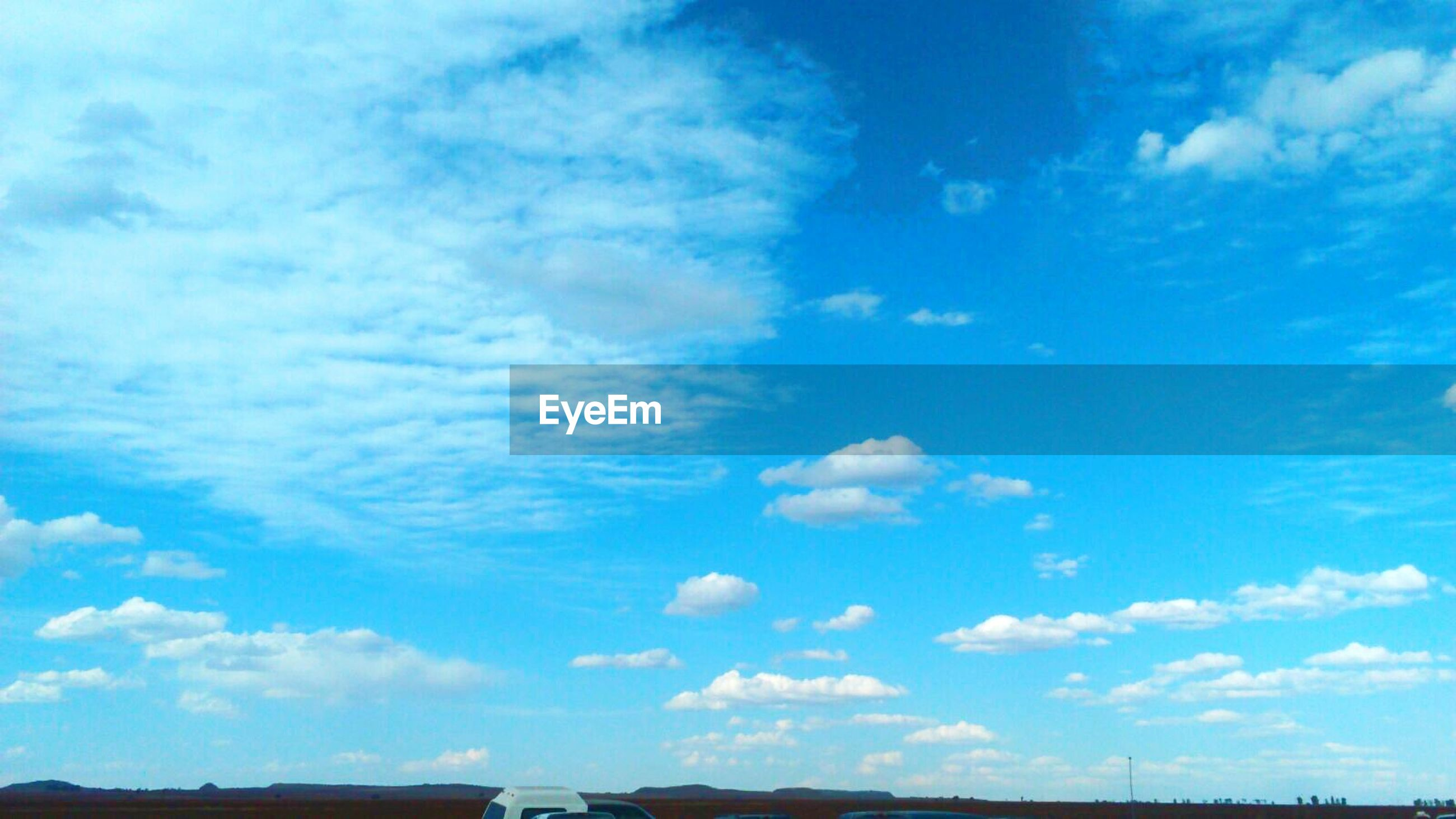 sky, blue, cloud - sky, beauty in nature, day, nature, scenics, no people, outdoors, tranquility, low angle view, backgrounds