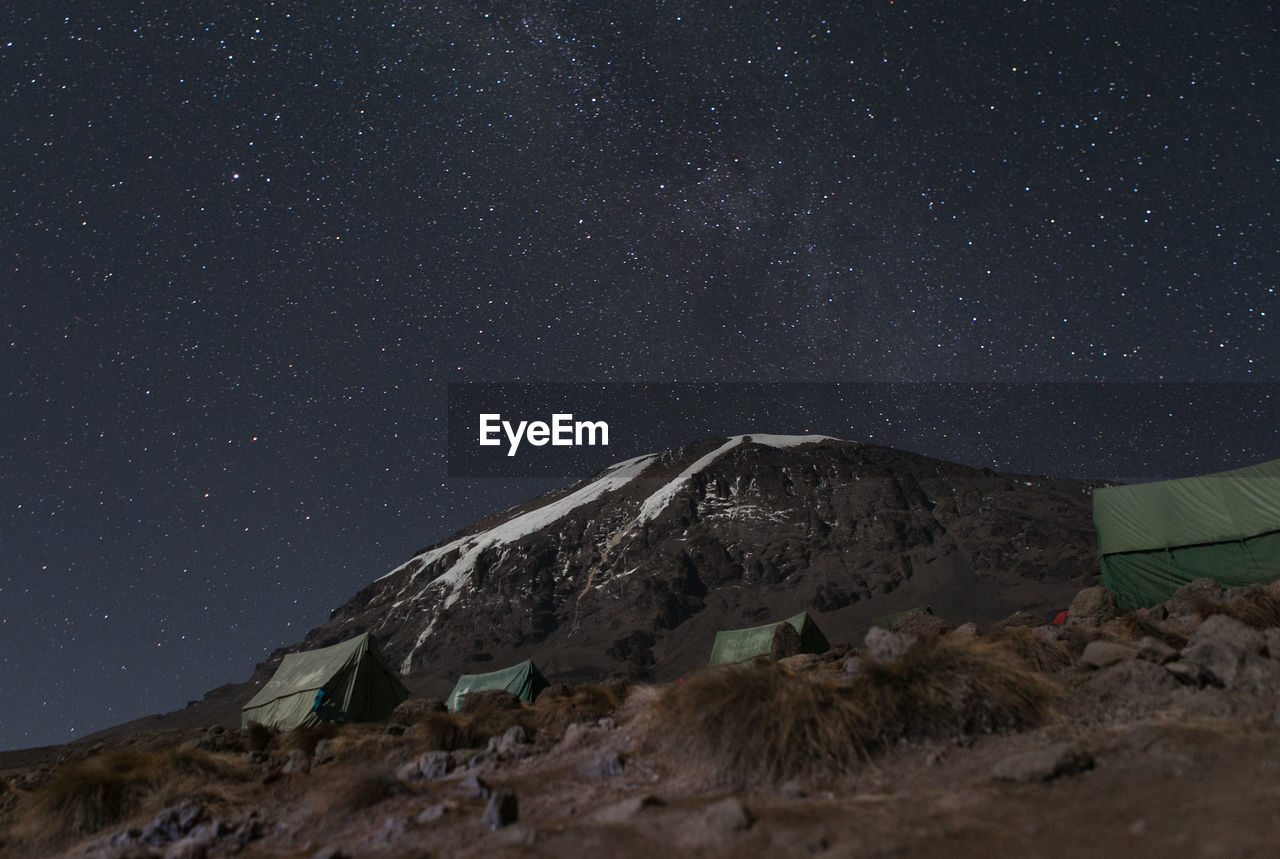 Low Angle View Of Mountain Against Star Field At Night
