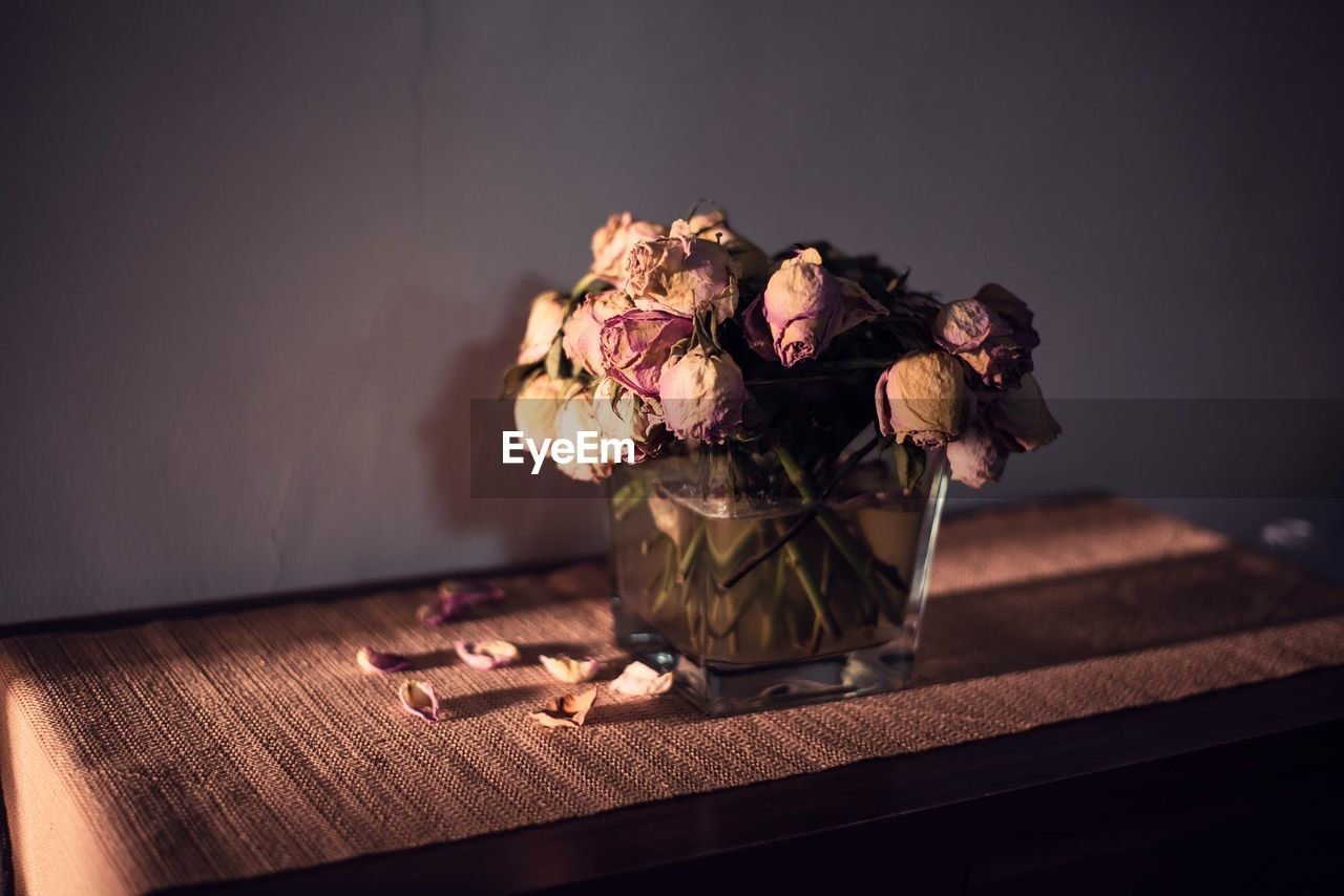 Dry Roses In Vase On Table At Home