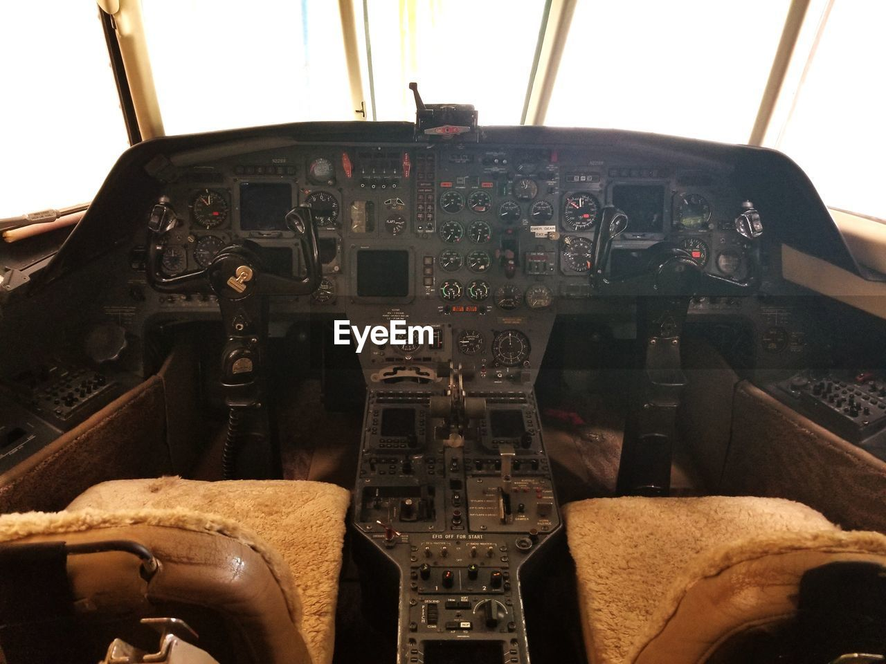air vehicle, mode of transportation, airplane, cockpit, transportation, vehicle interior, control, control panel, no people, travel, technology, indoors, day, aerospace industry, vehicle seat, military, close-up, seat, pilot, dashboard