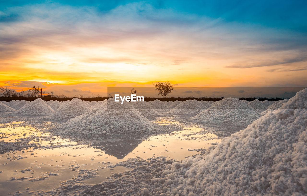 Salt farm in the morning with sunrise sky. organic sea salt. iodine salt.