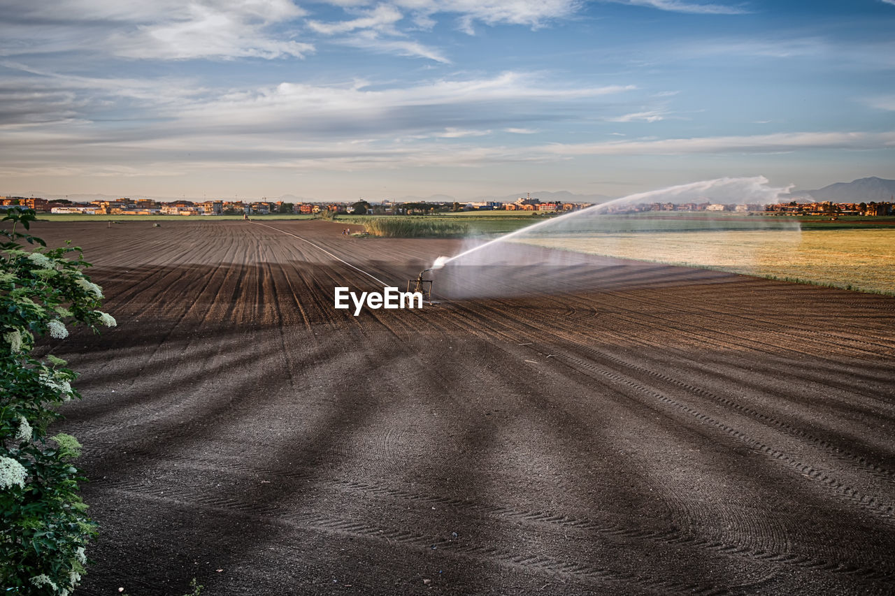 High angle view of sprinklers watering agricultural field