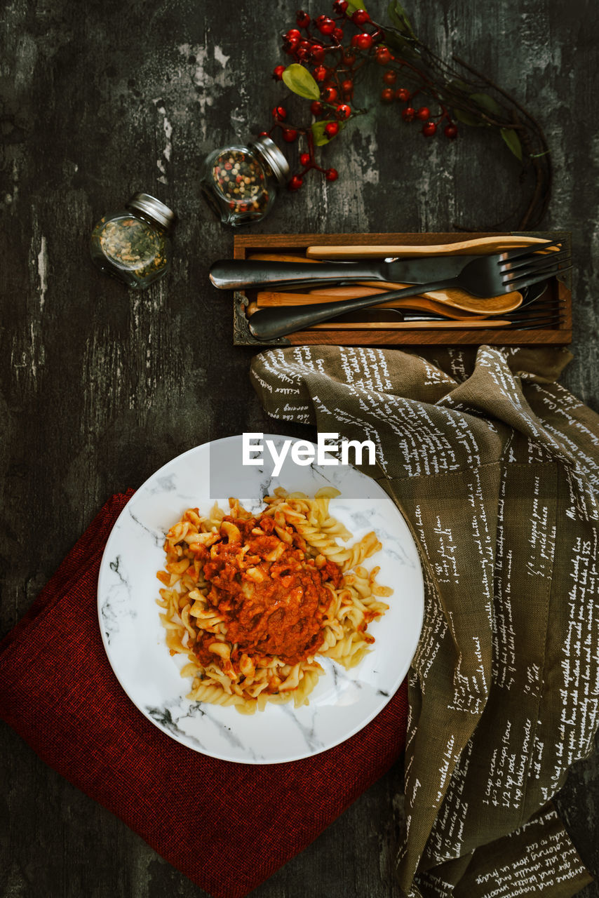 table, freshness, directly above, plate, food and drink, ready-to-eat, food, indoors, no people, kitchen utensil, healthy eating, still life, wellbeing, chopsticks, high angle view, bowl, serving size, italian food, eating utensil, close-up, garnish