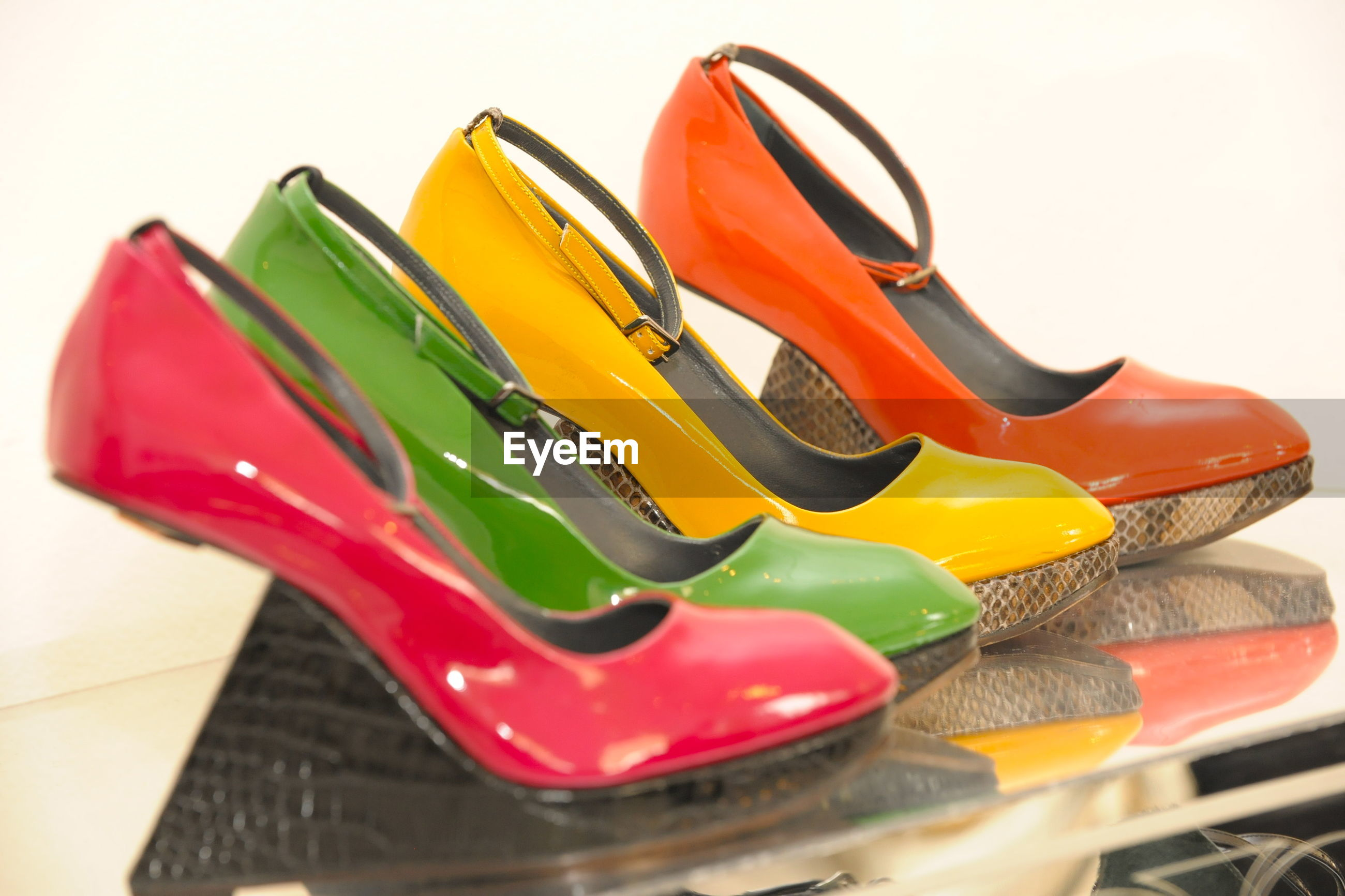 Close-up of multi colored high heels on table