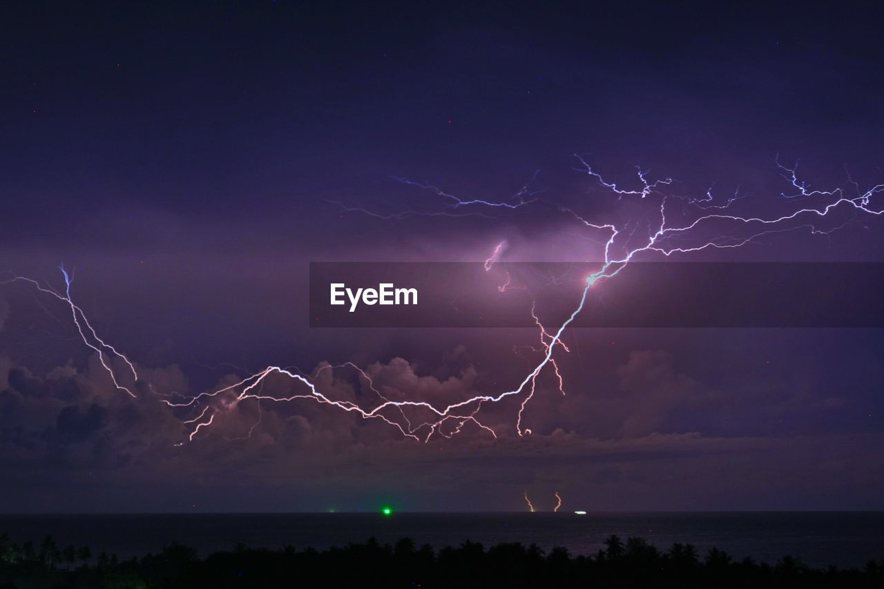 lightning, sky, power in nature, cloud - sky, storm, beauty in nature, power, night, thunderstorm, scenics - nature, nature, water, forked lightning, dramatic sky, illuminated, storm cloud, environment, no people, outdoors, electricity, purple