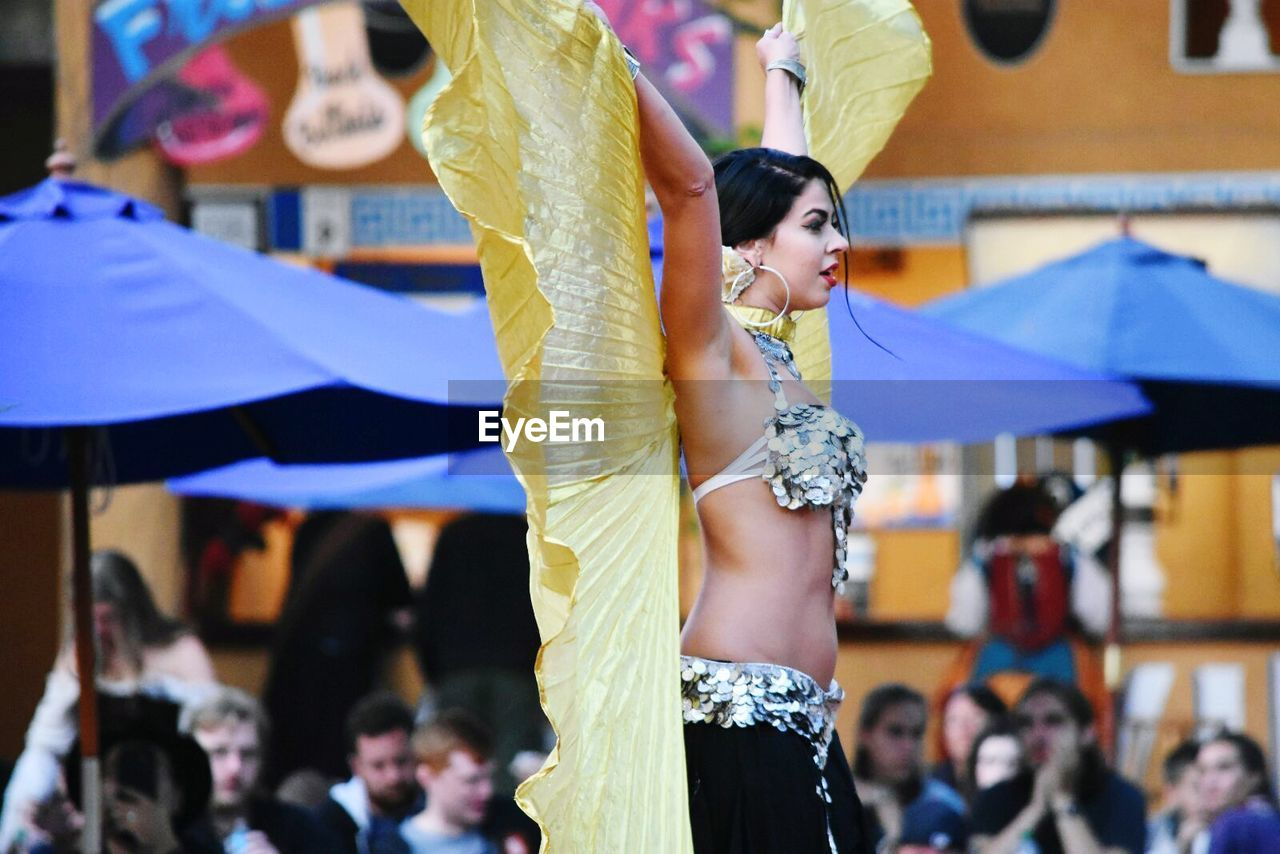 focus on foreground, dancing, real people, performance, incidental people, large group of people, stage costume, women, dancer, lifestyles, performing arts event, enjoyment, celebration, traditional dancing, leisure activity, arts culture and entertainment, fashion, skill, day, men, outdoors, young adult, adult, people