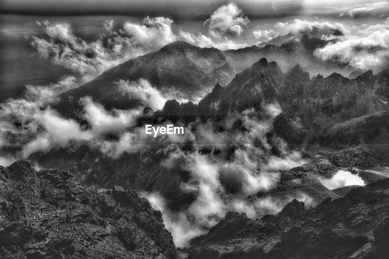 mountain, cloud - sky, beauty in nature, scenics - nature, sky, tranquil scene, nature, tranquility, no people, day, non-urban scene, mountain range, environment, landscape, outdoors, idyllic, remote, majestic, cloudscape, mountain peak, formation