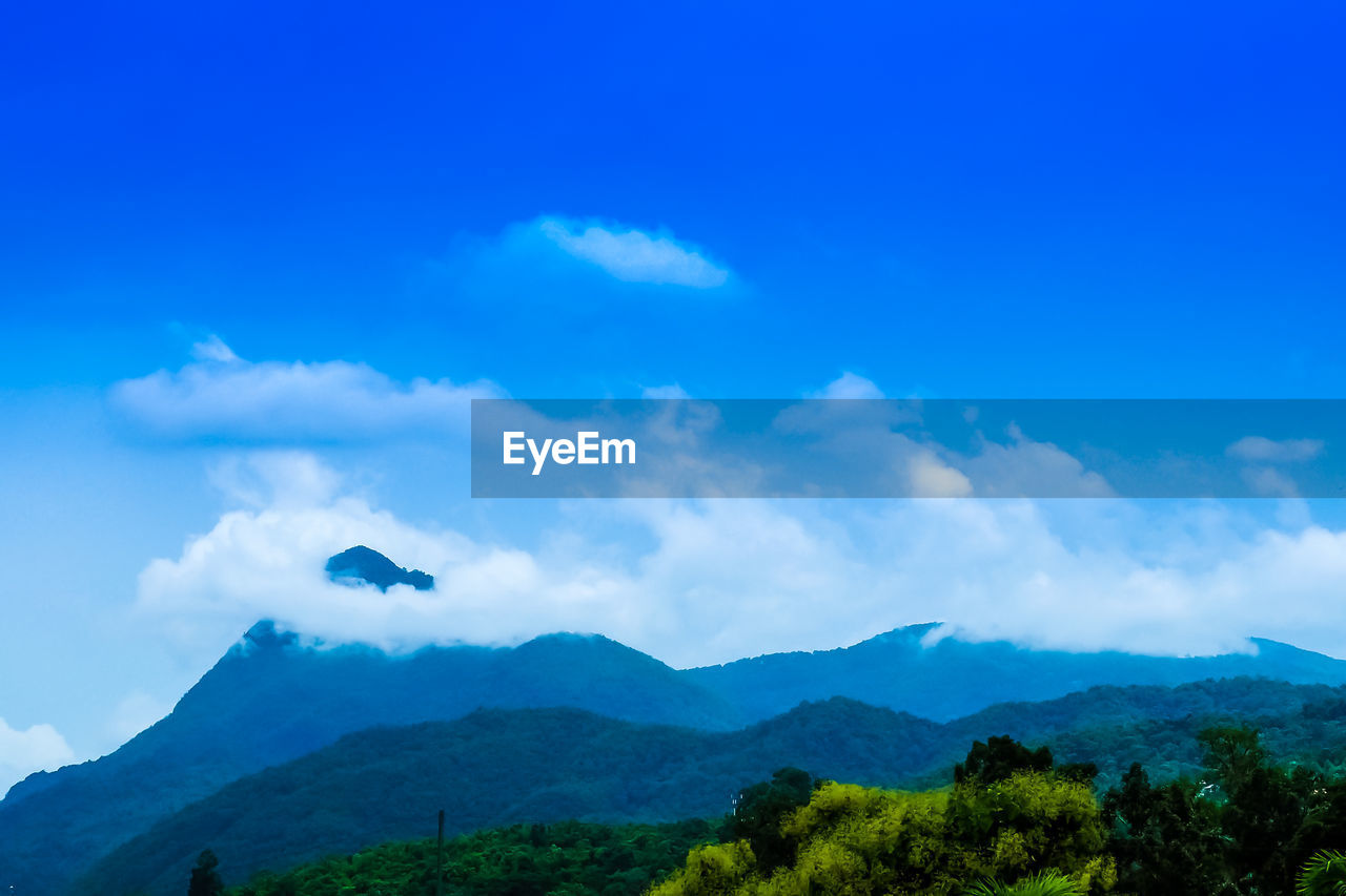 nature, beauty in nature, blue, sky, mountain, tranquility, tranquil scene, day, scenics, outdoors, cloud - sky, no people, low angle view
