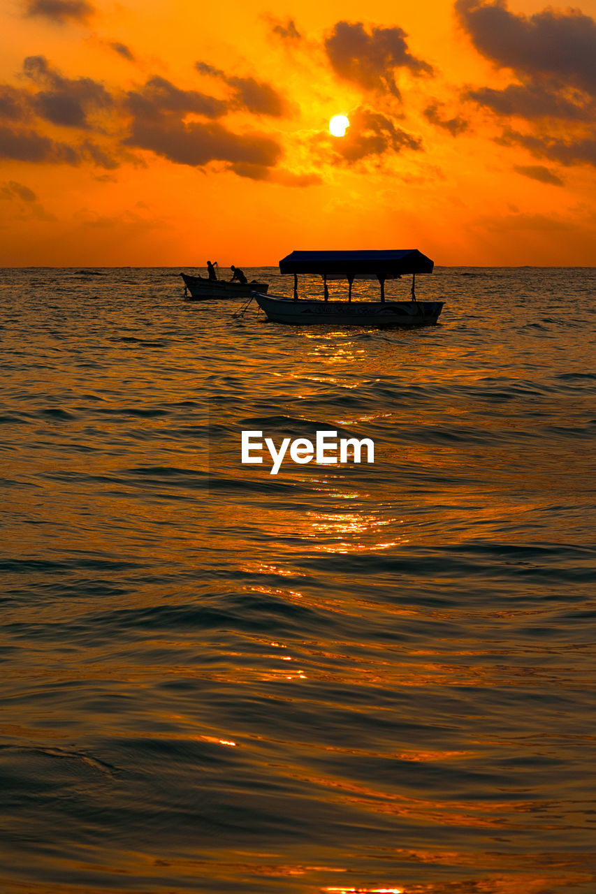 sunset, sky, water, sea, scenics - nature, beauty in nature, waterfront, orange color, cloud - sky, horizon, horizon over water, silhouette, tranquil scene, nautical vessel, tranquility, nature, transportation, idyllic, mode of transportation, outdoors, no people