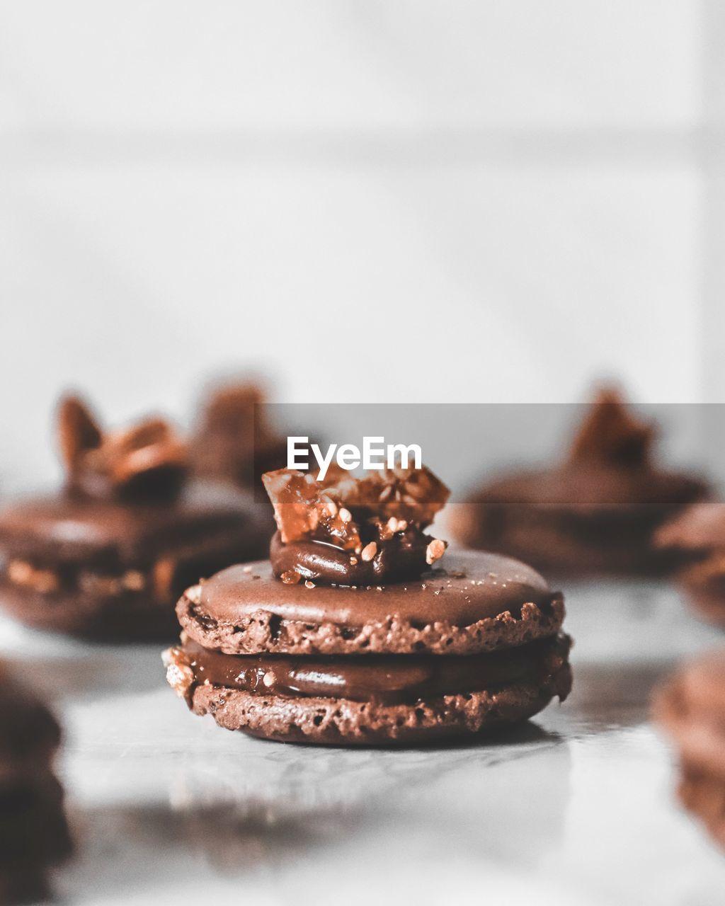 Close-up of chocolate caramel macarons on table