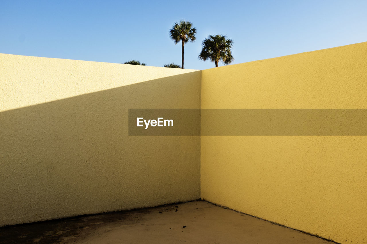Yellow Wall Against Blue Sky