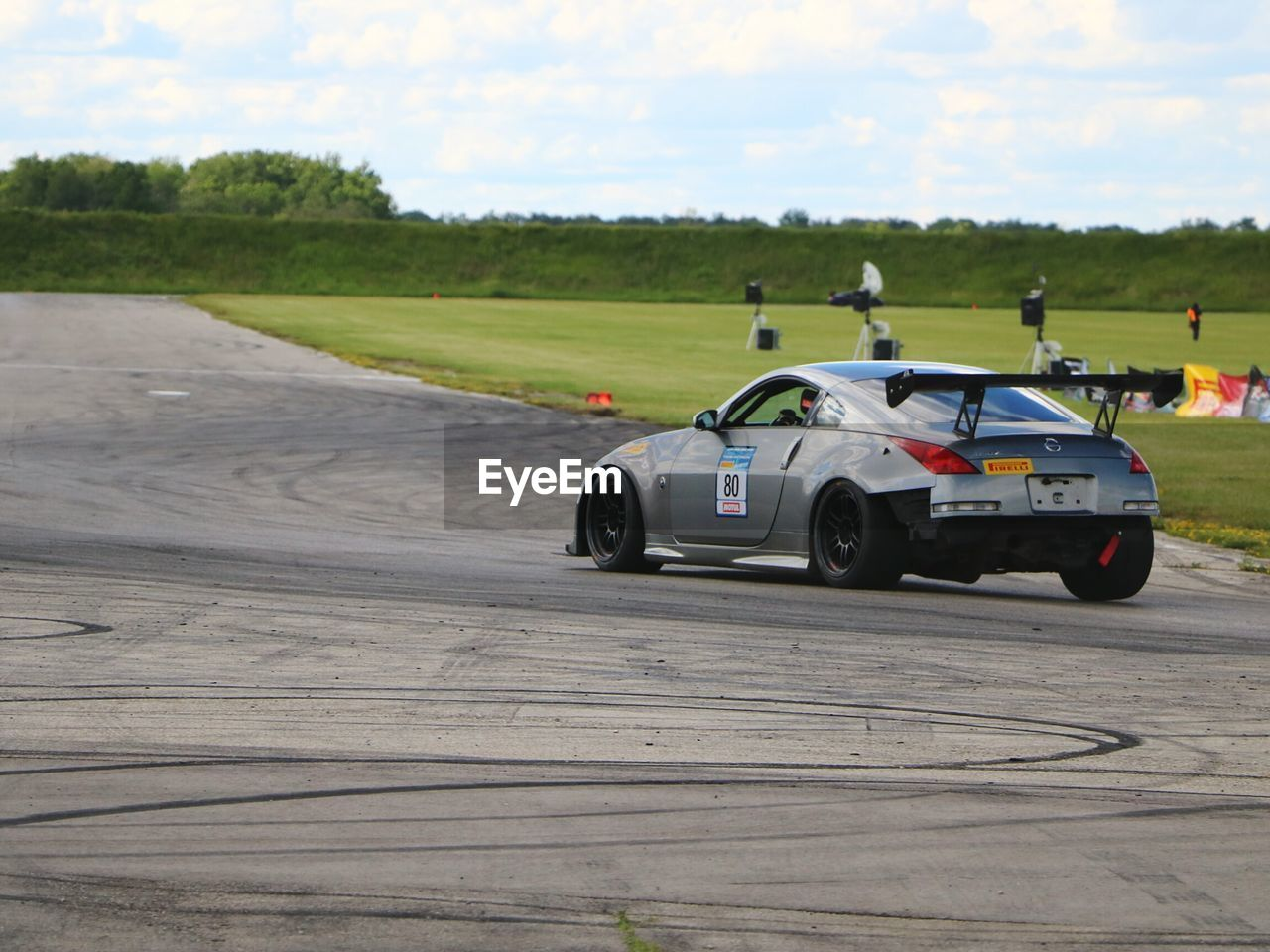 transportation, land vehicle, mode of transport, car, sky, day, outdoors, no people, racecar, auto racing