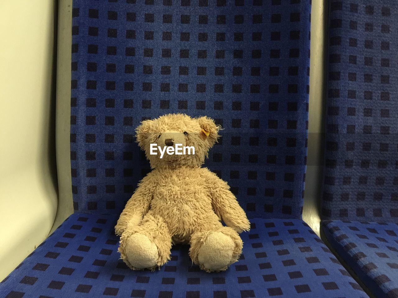 Close-Up Of Teddy Bear On Seat