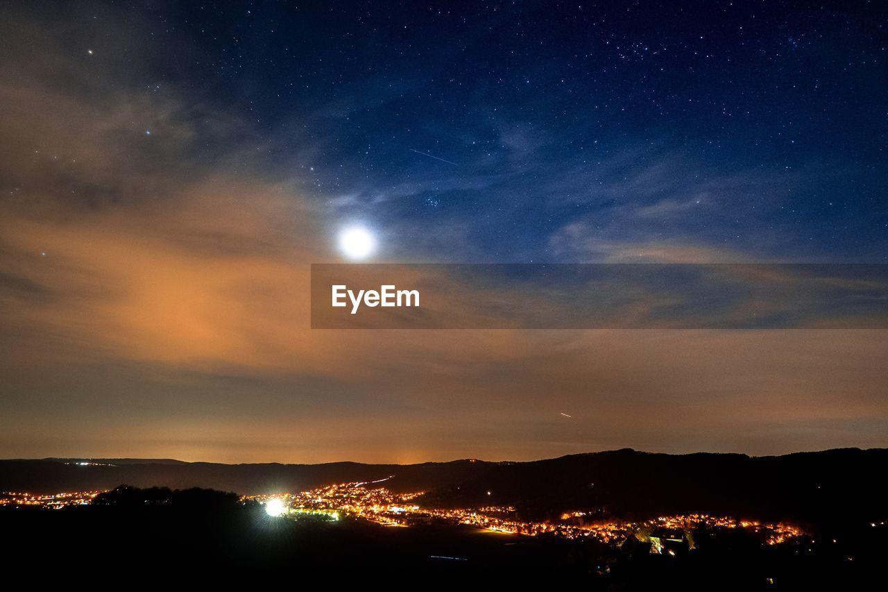 sky, night, no people, beauty in nature, scenics, nature, star - space, sunset, silhouette, cloud - sky, illuminated, architecture, outdoors, mountain, cityscape, city, astronomy