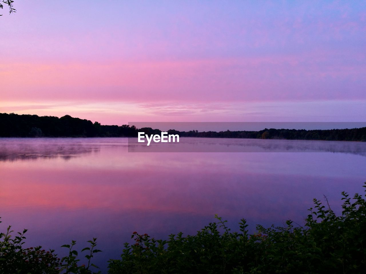 beauty in nature, tranquil scene, nature, tranquility, scenics, water, reflection, lake, idyllic, sunset, sky, no people, outdoors, tree, standing water, purple, day