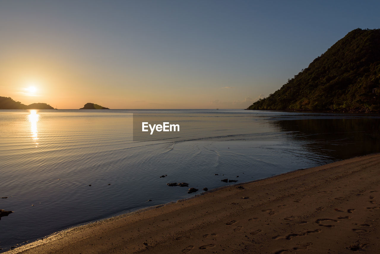 tranquility, scenics, nature, tranquil scene, water, sea, beauty in nature, sunset, beach, sand, sky, no people, outdoors, day