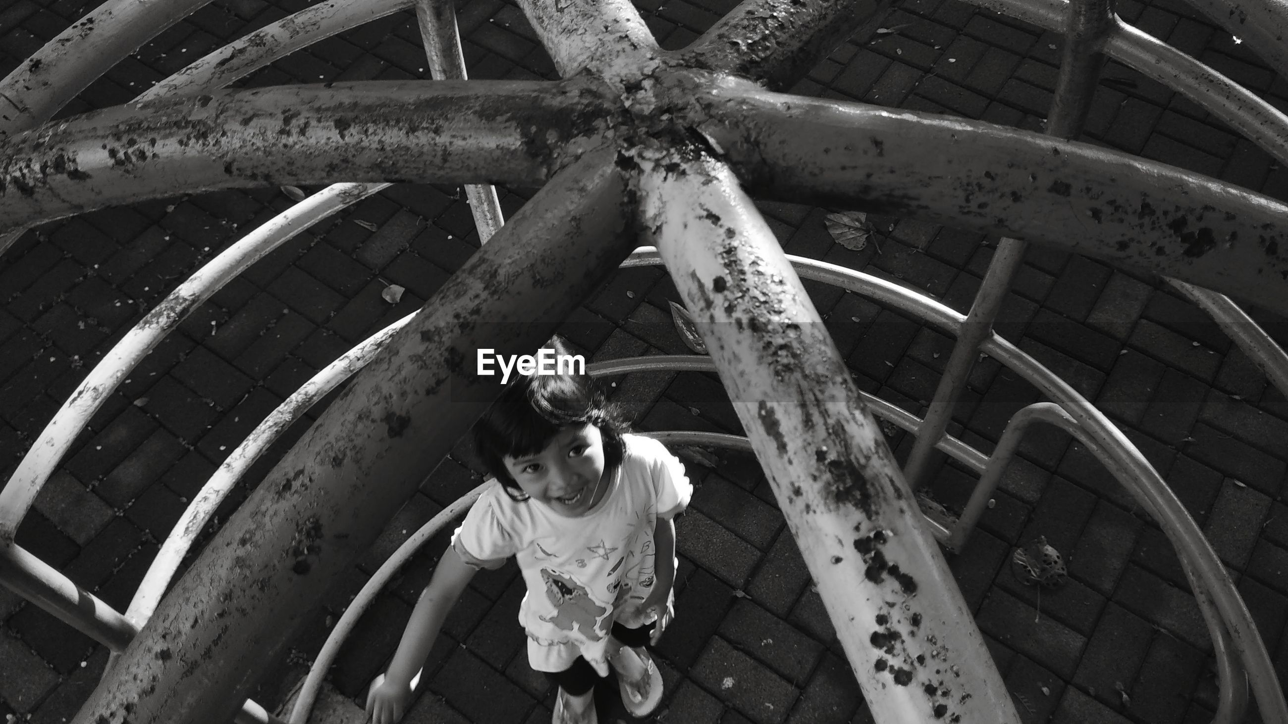 High angle portrait of girl standing on playground