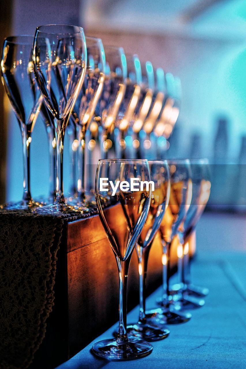 Wine glasses arranged on table