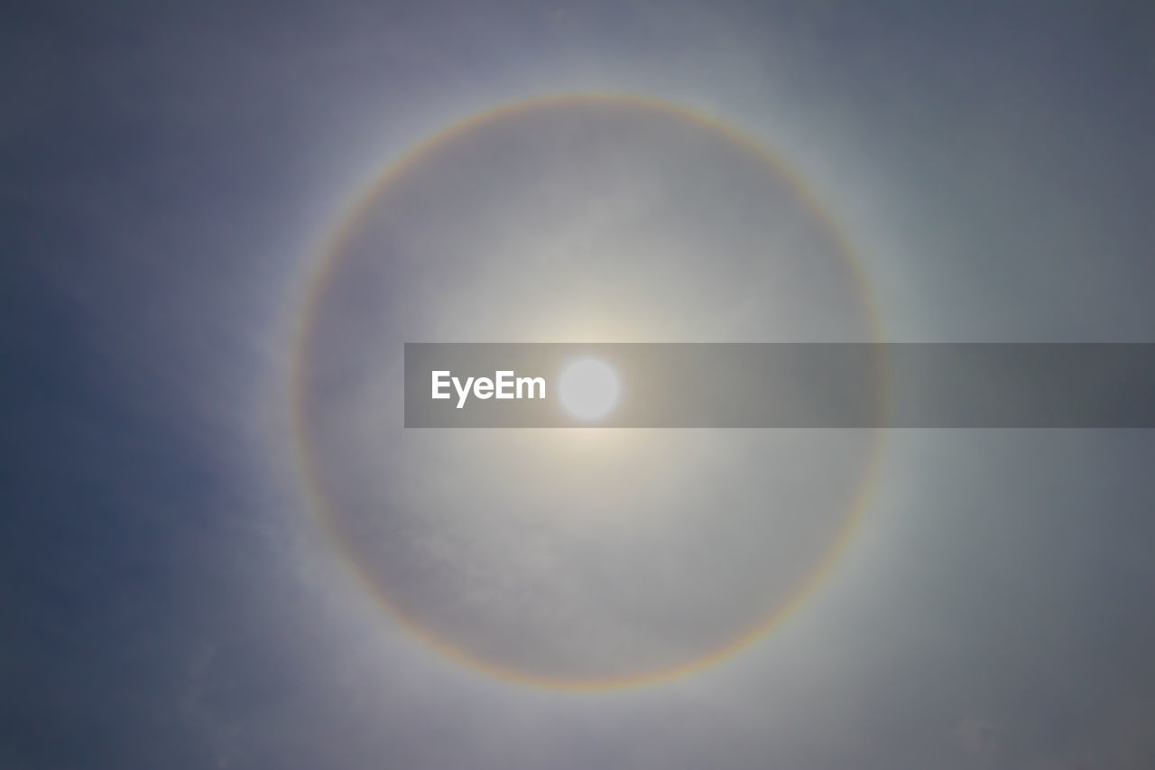 beauty in nature, sky, geometric shape, circle, natural phenomenon, nature, astronomy, shape, tranquility, no people, eclipse, halo, scenics - nature, rainbow, sunlight, sun, space, tranquil scene, outdoors, low angle view, lens flare, moonlight