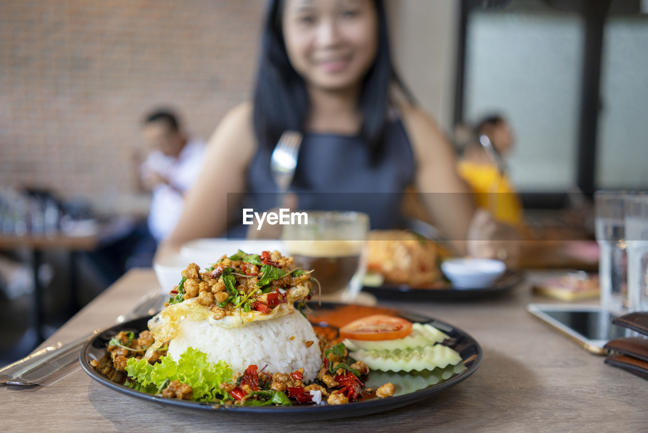 Portrait of woman having food in restaurant