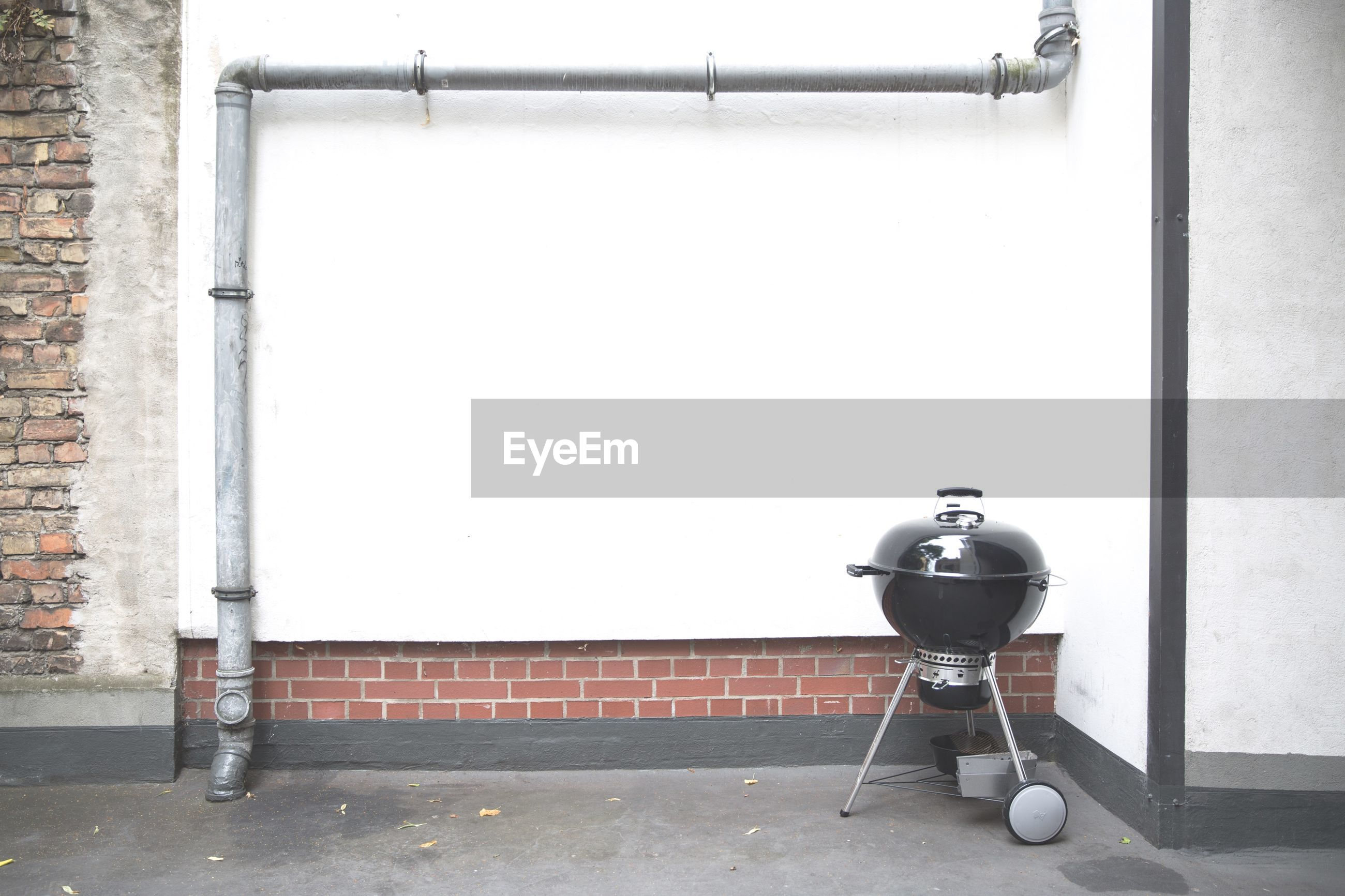 Barbeque grill against wall