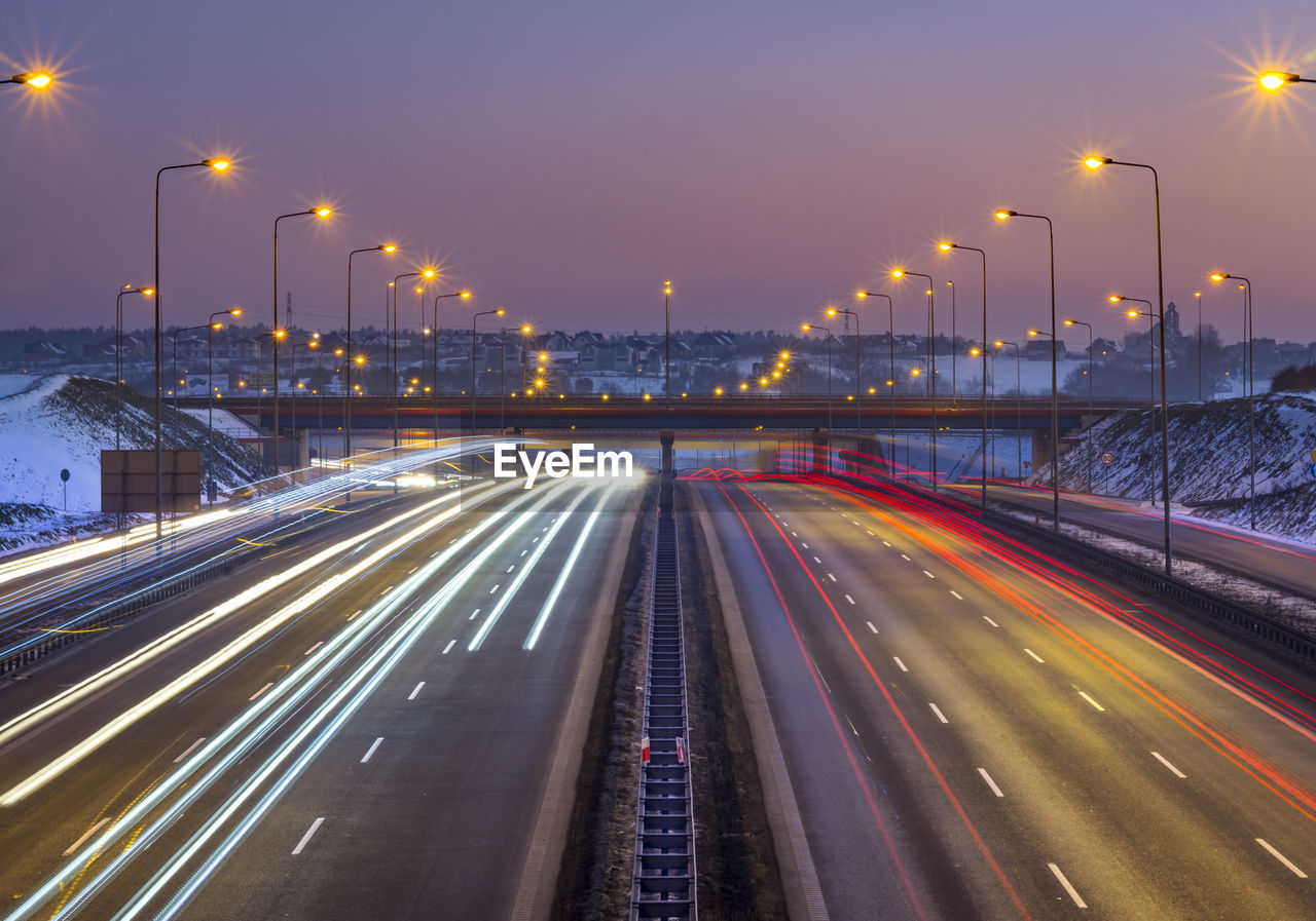 High Angle View Of Light Trails On Two Lane Highway