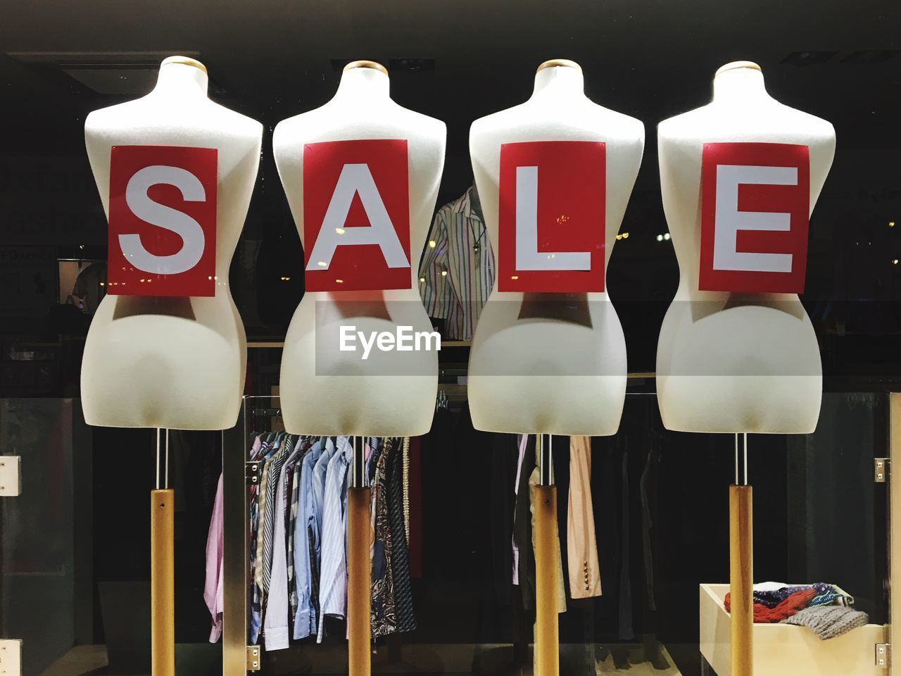 side by side, indoors, no people, large group of objects, still life, text, retail display, retail, in a row, western script, hanging, white color, sale, collection, mannequin, communication, for sale, close-up, store, arrangement
