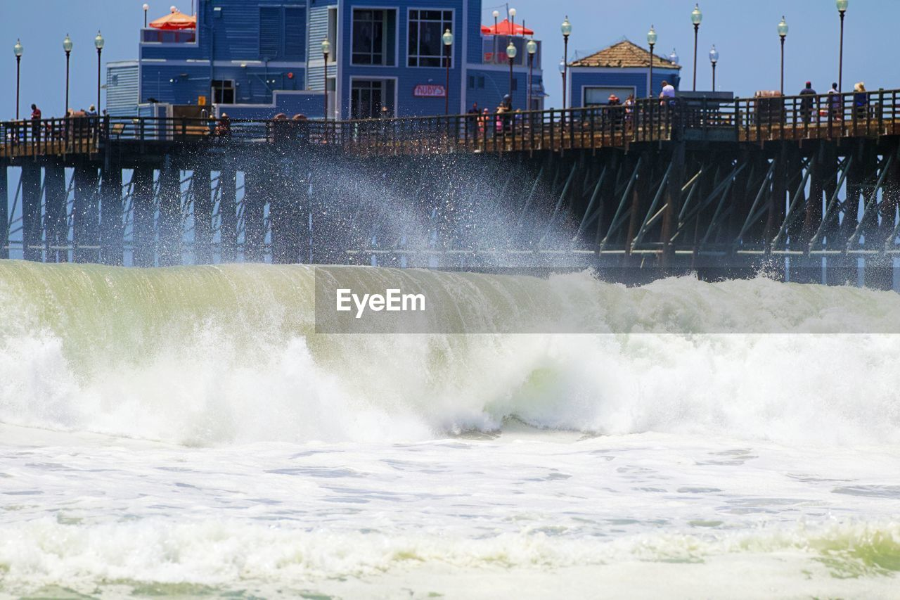 water, motion, built structure, architecture, power in nature, waterfront, sea, power, nature, building exterior, splashing, sport, beauty in nature, wave, aquatic sport, flowing water, no people, day, outdoors, flowing, hitting, breaking