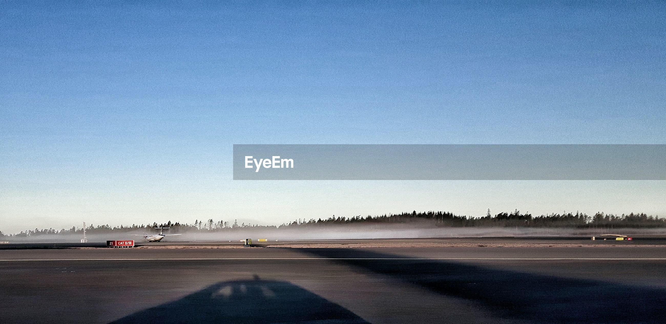 Airport runway at goteborg landvetter airport against clear sky
