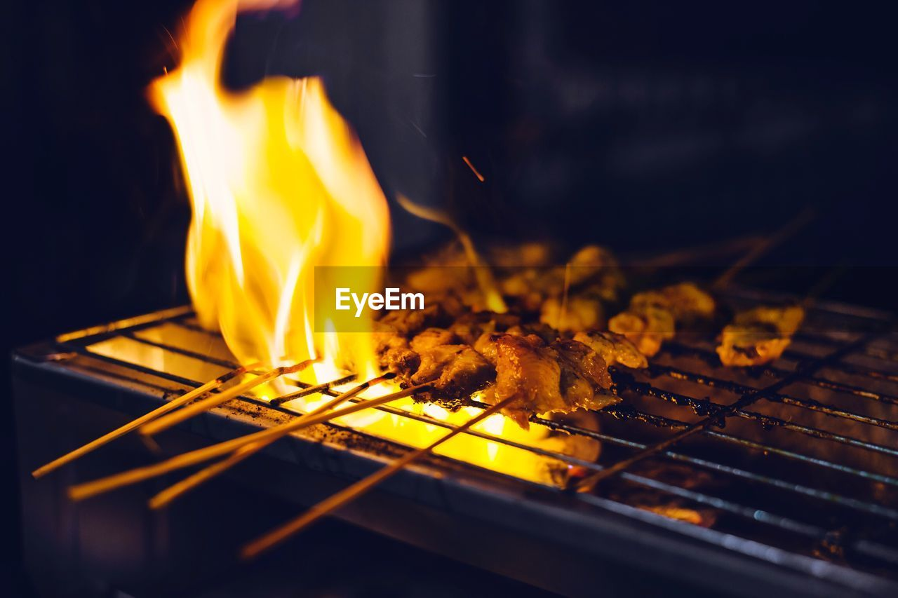 heat - temperature, burning, flame, fire, fire - natural phenomenon, food, nature, close-up, food and drink, barbecue, barbecue grill, glowing, freshness, preparation, no people, selective focus, grilled, orange color, wood - material, meat, preparing food, bonfire, matchstick