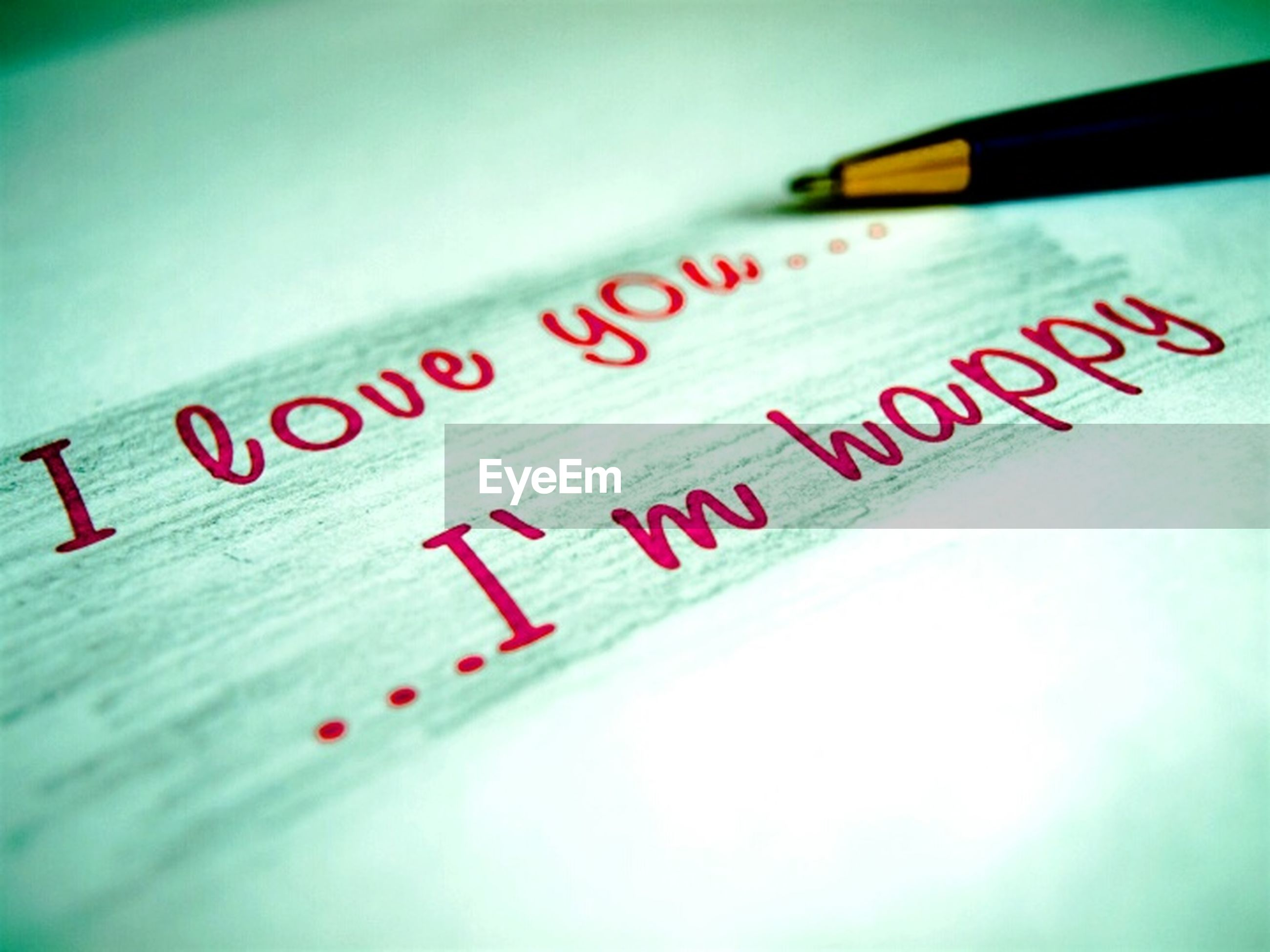 text, western script, communication, indoors, close-up, paper, capital letter, message, information, handwriting, number, selective focus, non-western script, no people, red, guidance, sign, writing, still life, table