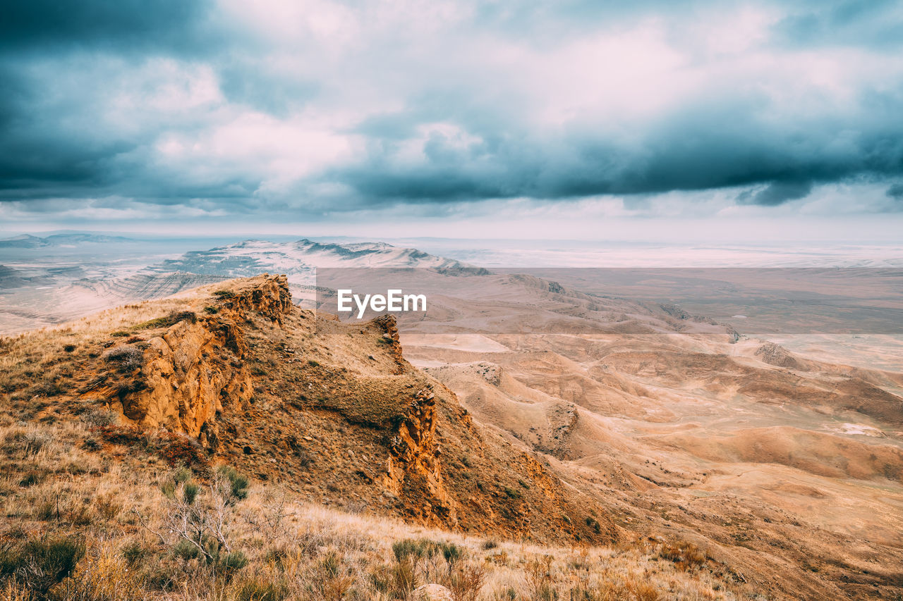 cloud - sky, sky, scenics - nature, beauty in nature, tranquility, tranquil scene, non-urban scene, environment, no people, nature, landscape, idyllic, remote, day, outdoors, land, mountain, rock, cloudscape, arid climate
