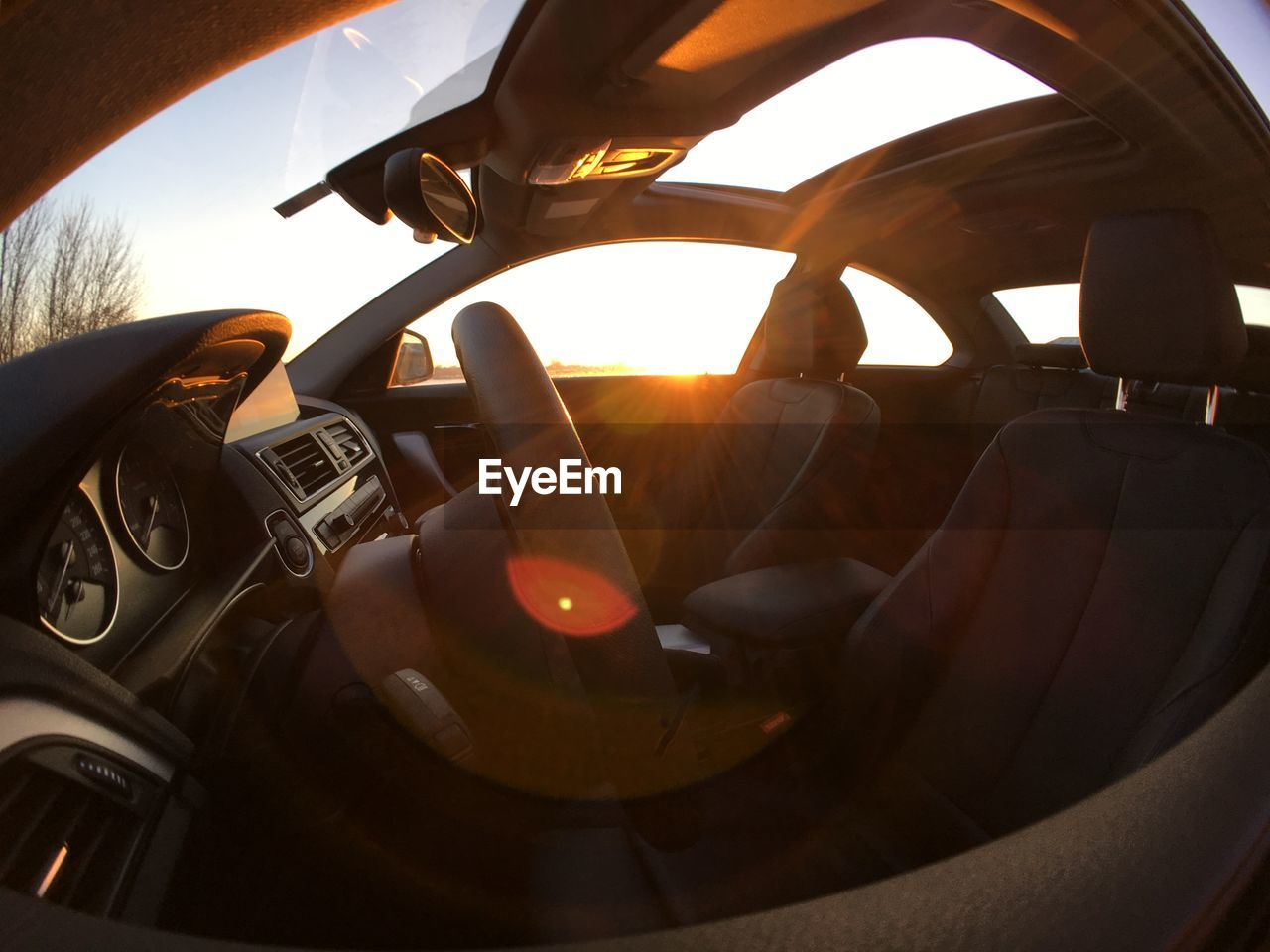 vehicle interior, car interior, transportation, steering wheel, car, human hand, one person, dashboard, close-up, human body part, real people, day, speedometer, men, sky, outdoors, people