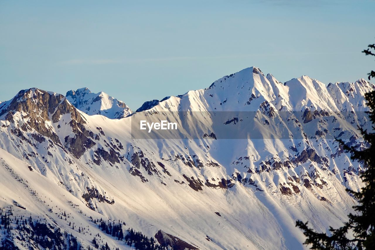 mountain, snow, cold temperature, winter, beauty in nature, sky, scenics - nature, mountain range, tranquility, snowcapped mountain, tranquil scene, environment, nature, day, non-urban scene, white color, idyllic, landscape, mountain peak, no people, extreme weather, formation