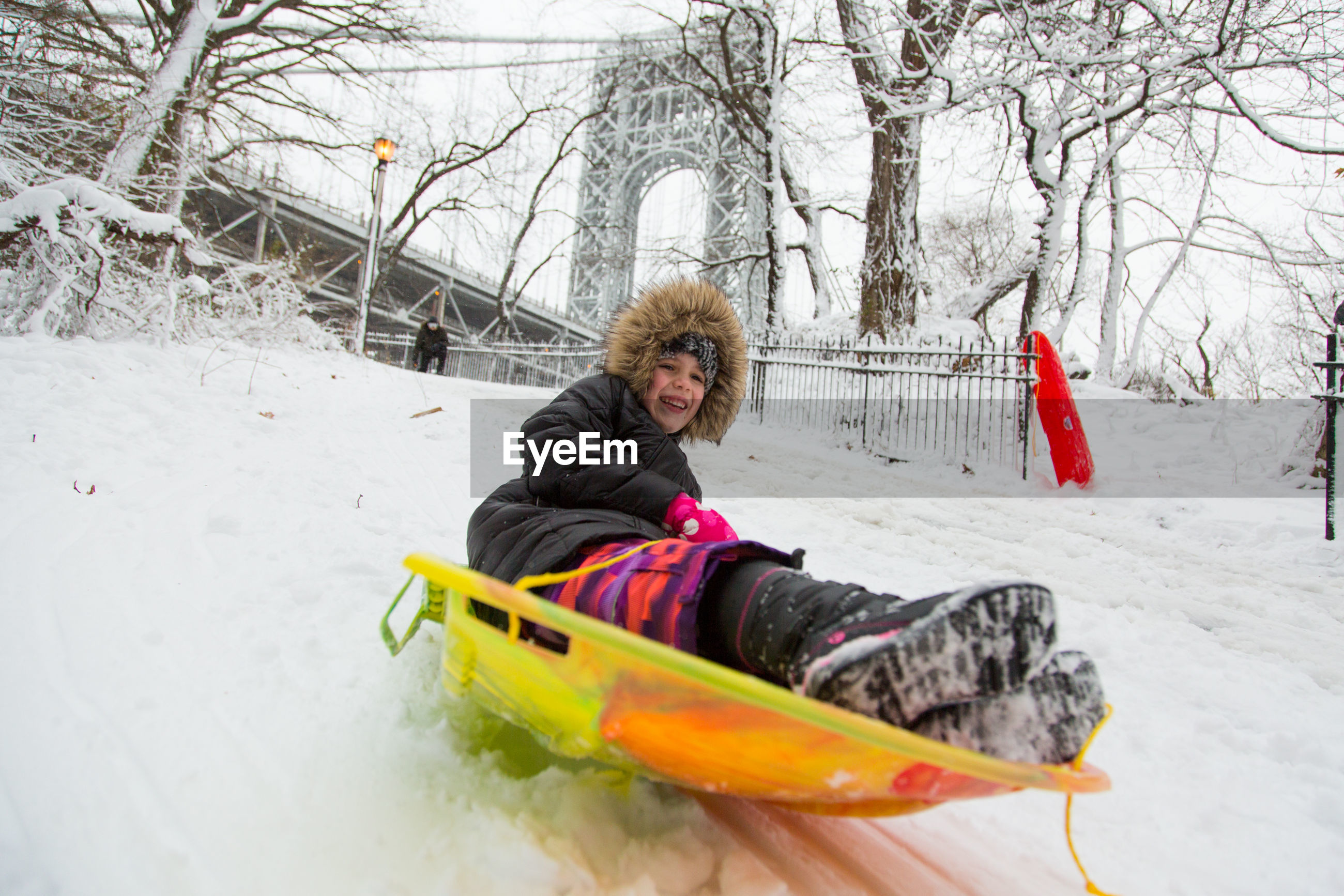 winter, snow, cold temperature, warm clothing, child, one person, knit hat, people, one woman only, bare tree, outdoors, only women, day, snowing, tobogganing, adult