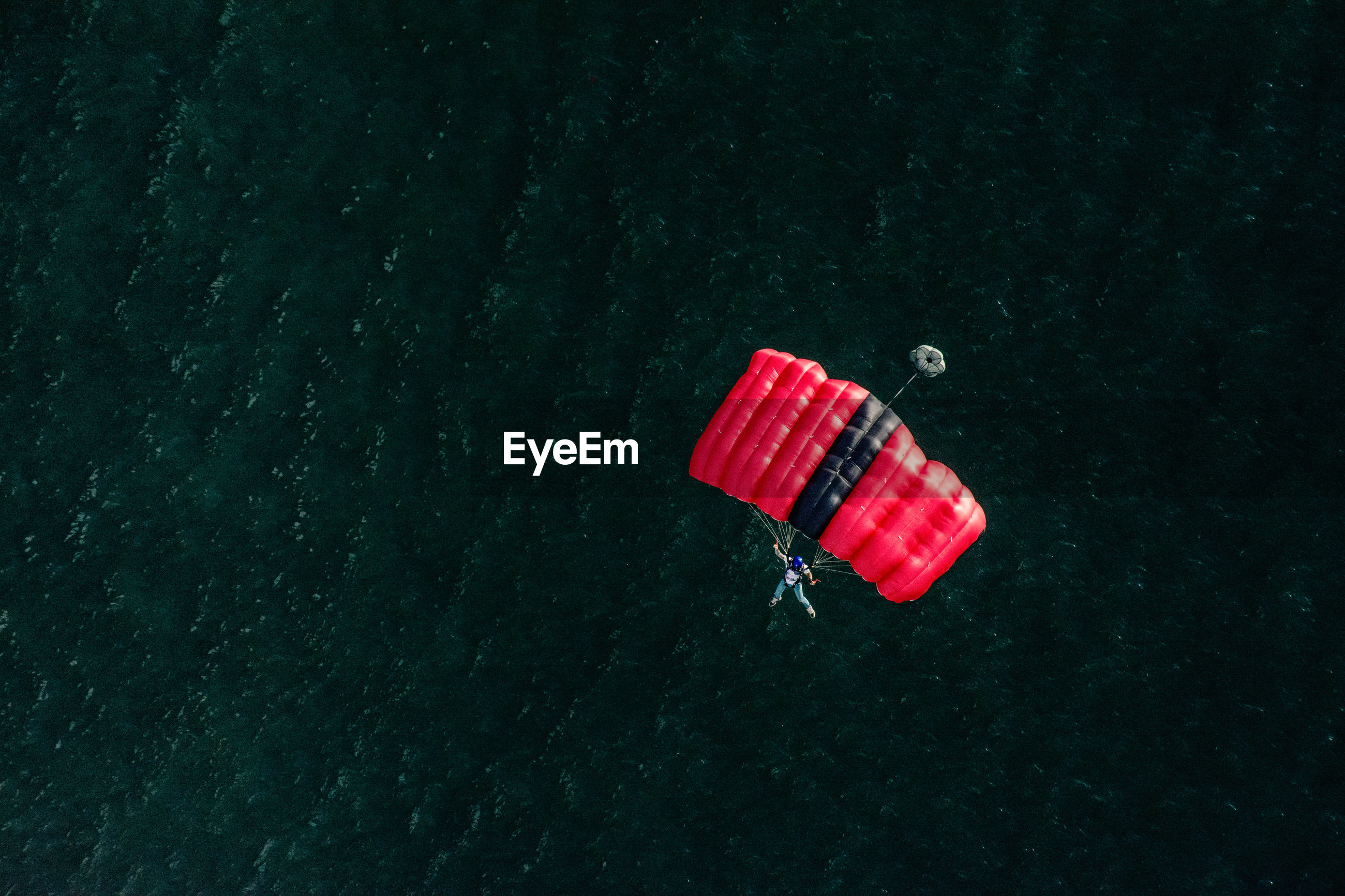 High angle view of man paragliding over sea